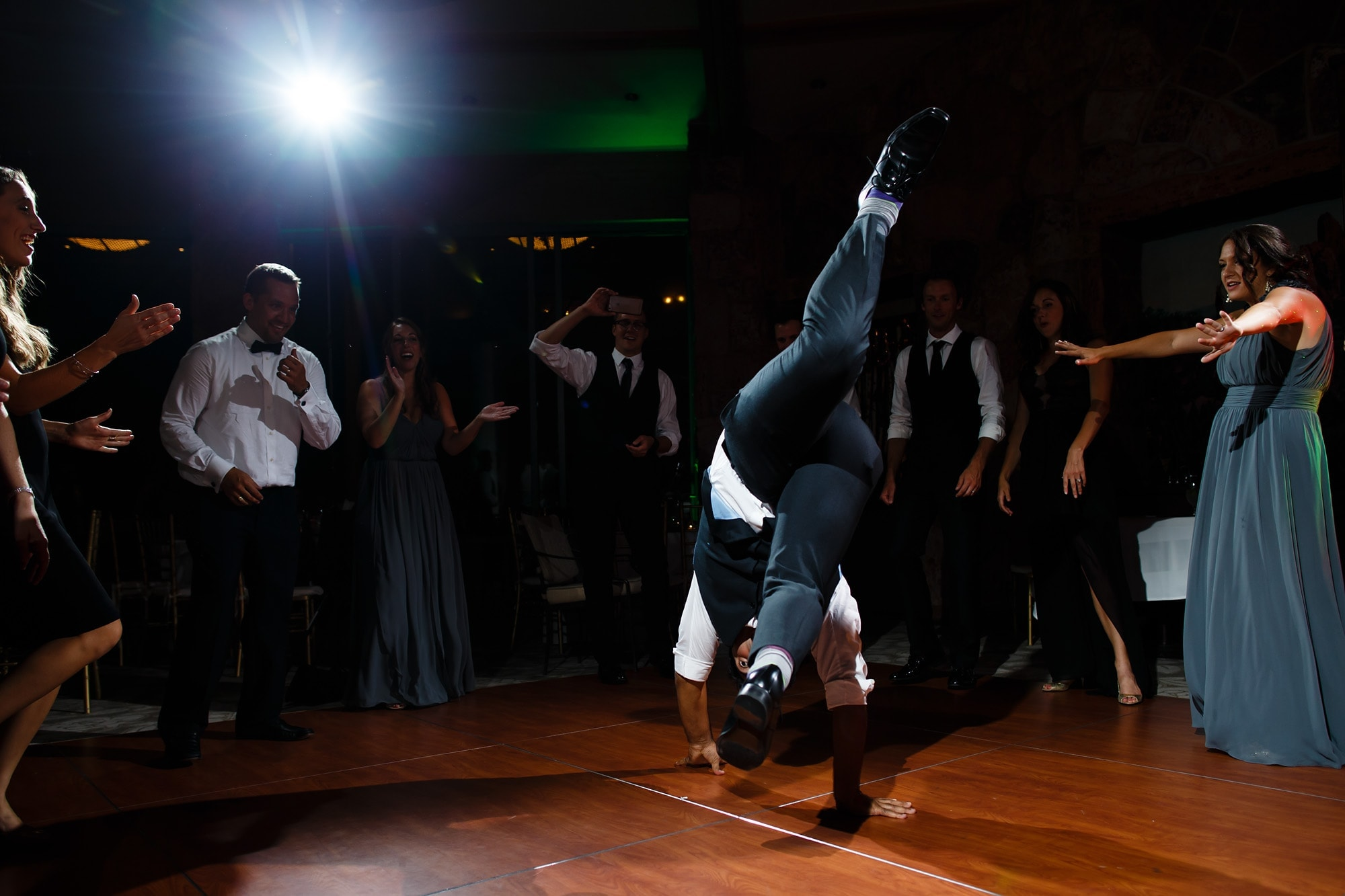 Break dancing during the reception at Garden of the Gods Club for Joshua and Devan's wedding