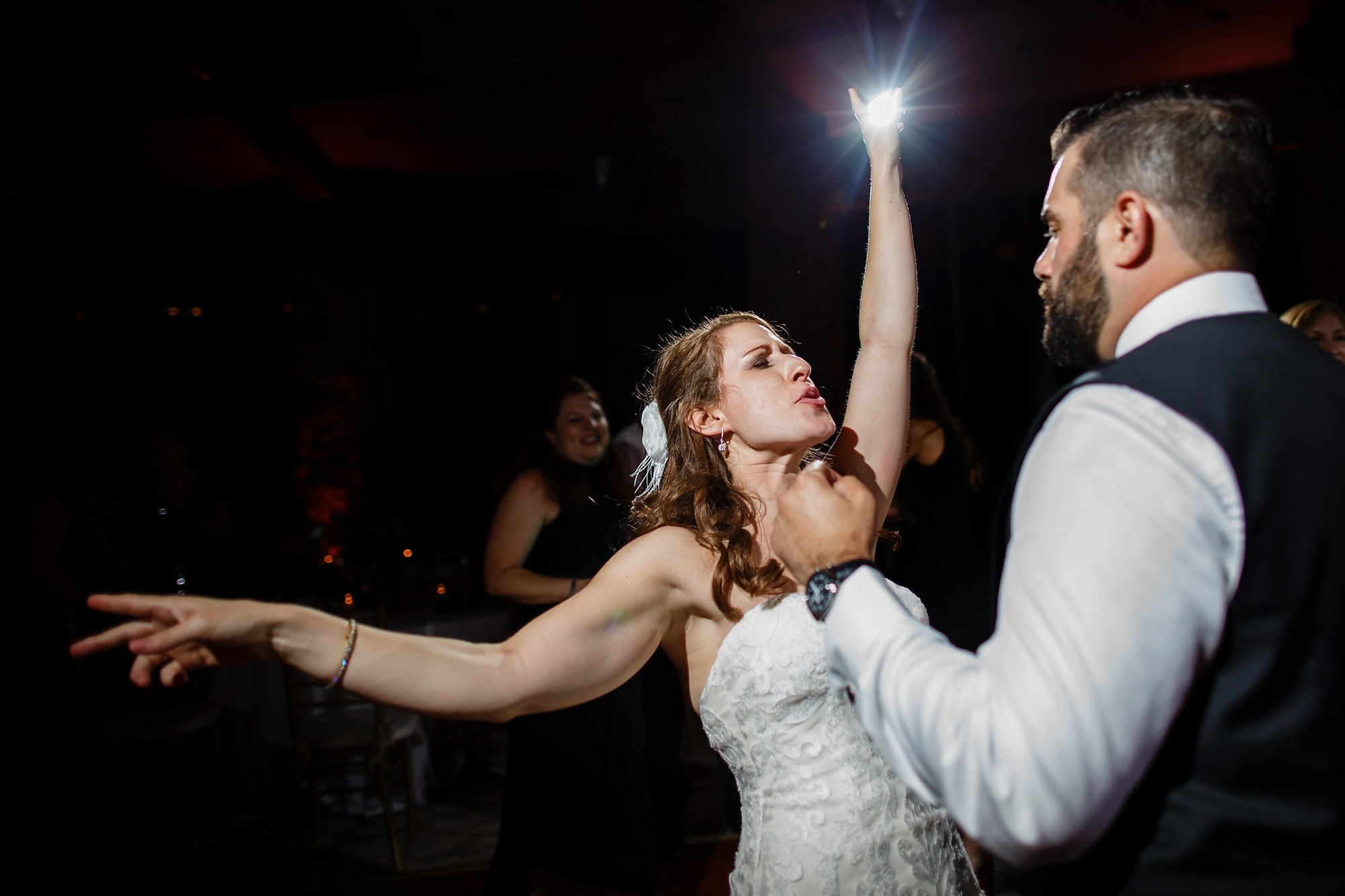 The bride and groom dance together during their reception at Garden of the Gods Club