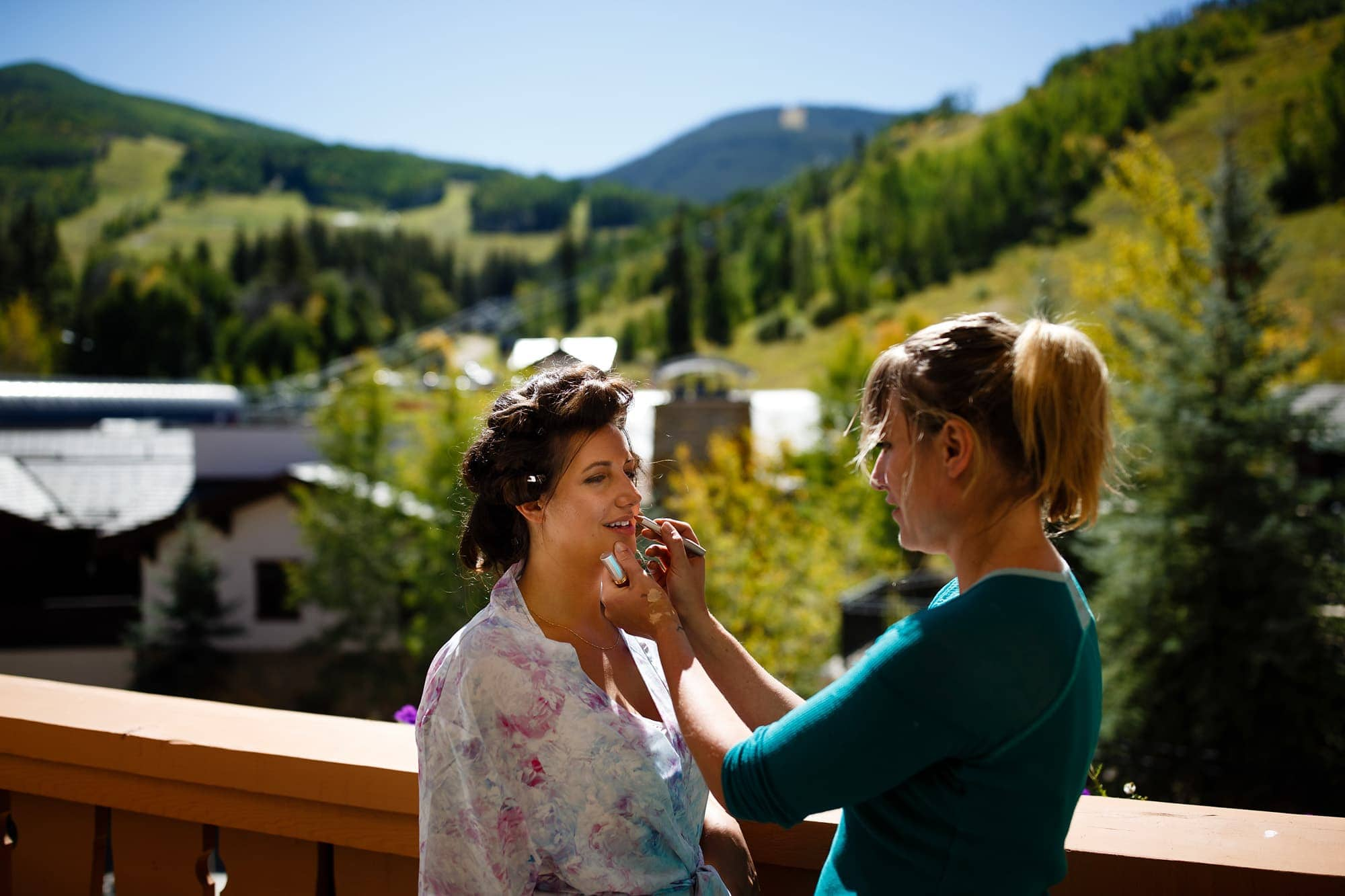 Vail village serves as a backdrop as Becky has her makeup done at The Lodge at Vail.