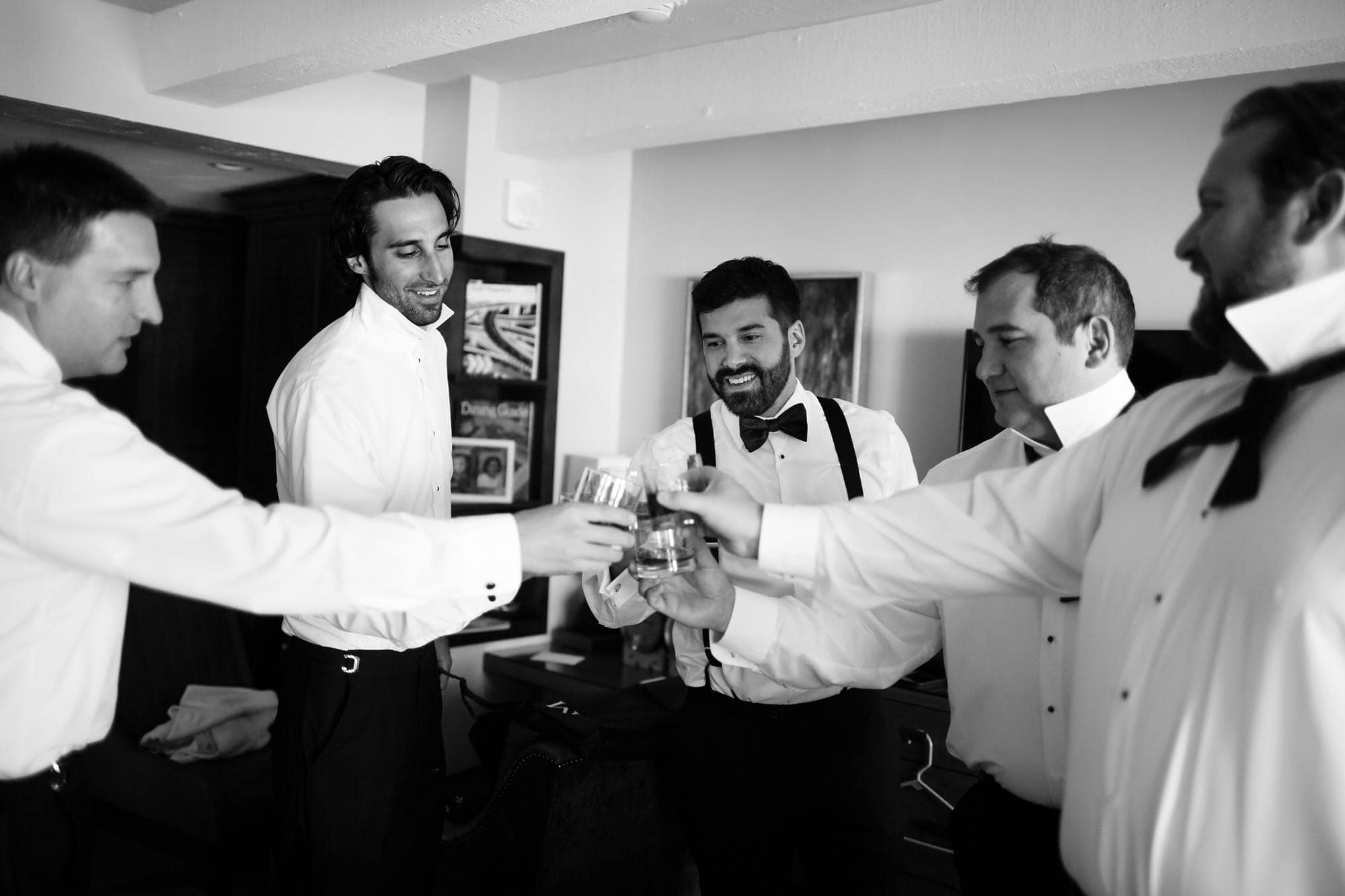 Brian shares a toast with his groomsmen before the wedding in Vail, Colorado.