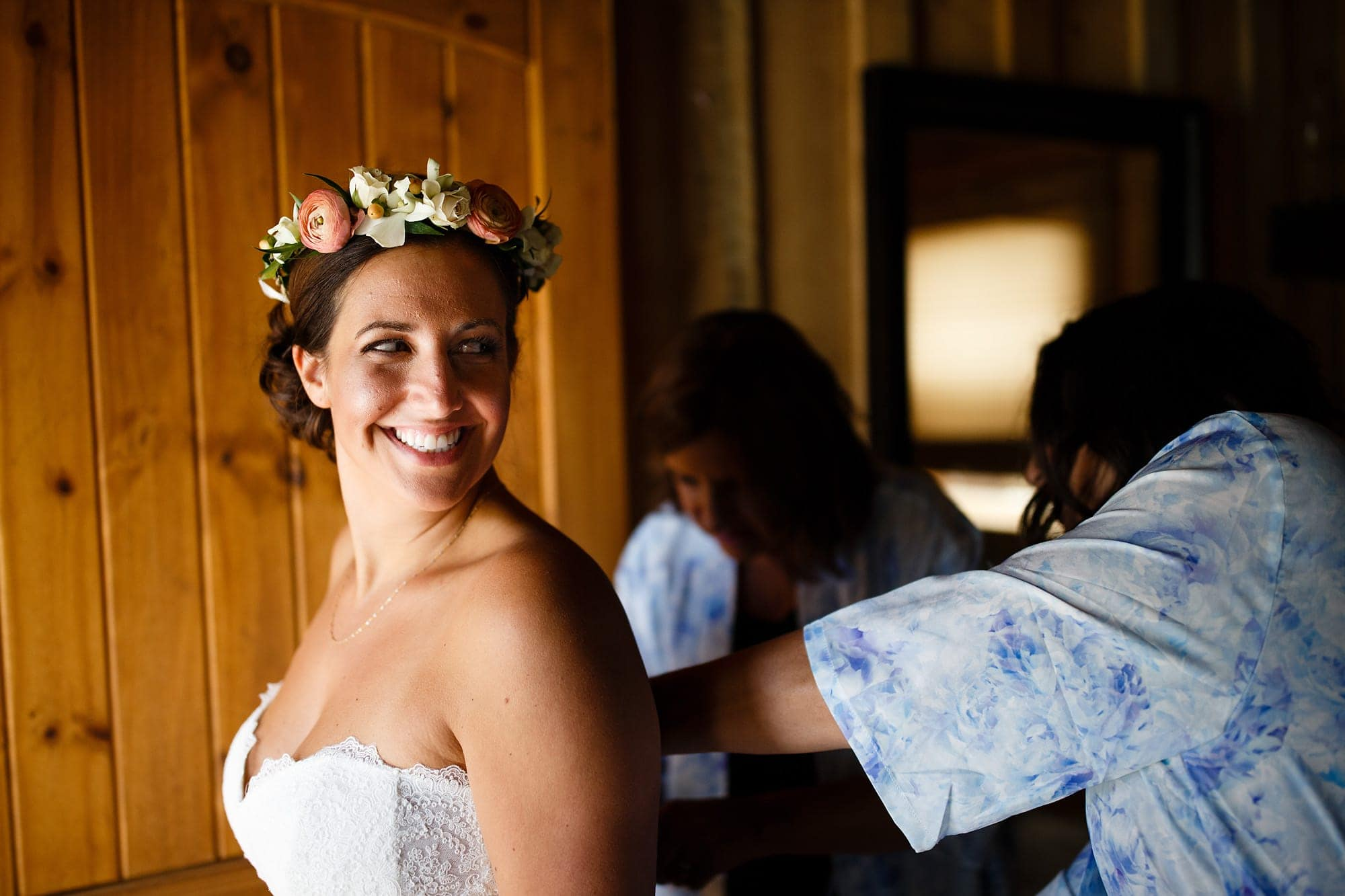 Becky puts her two-piece wedding dress on at Piney River Ranch.