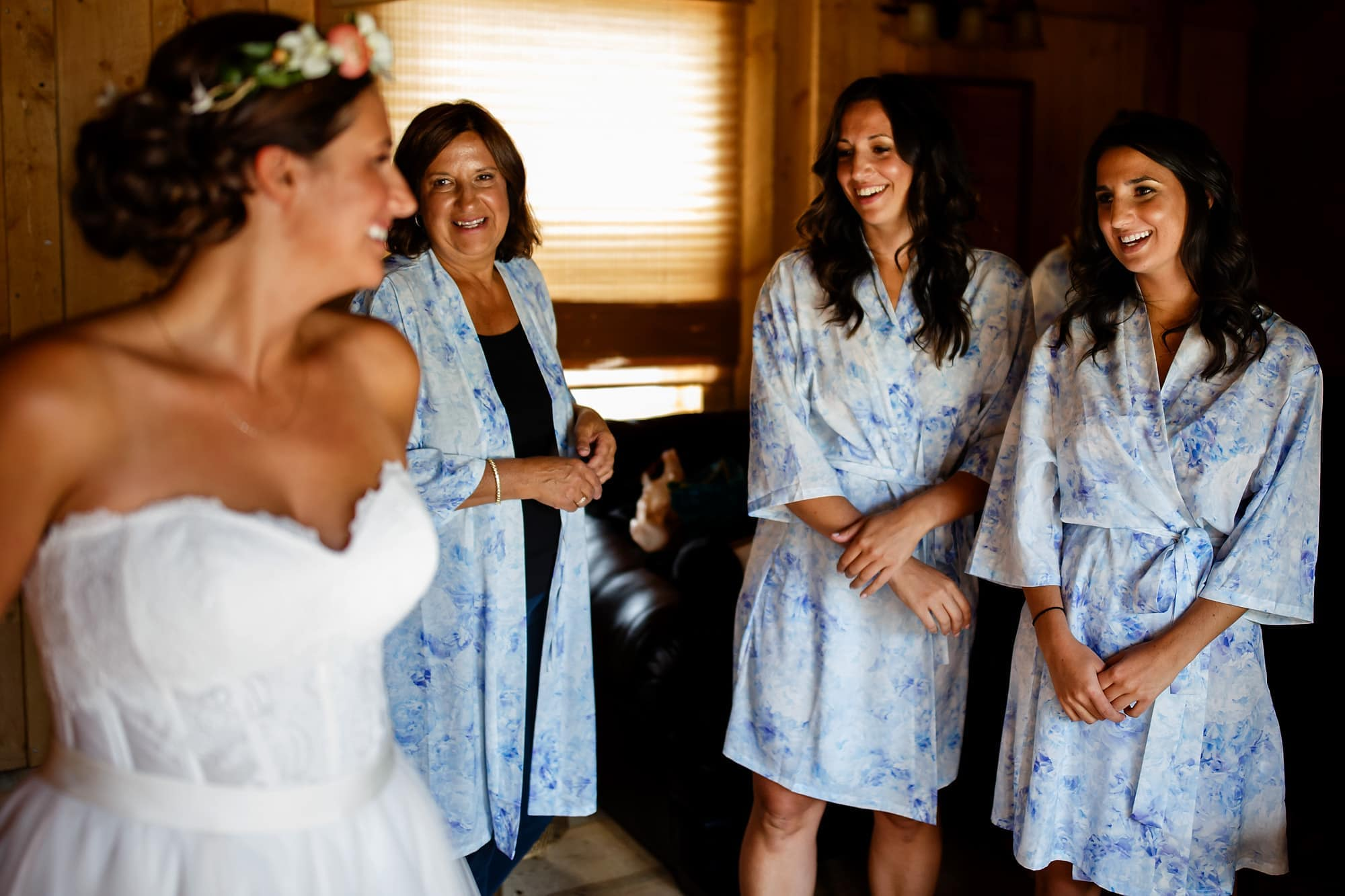 Becky's sisters and mother get their first look of the bride at Piney River Ranch.