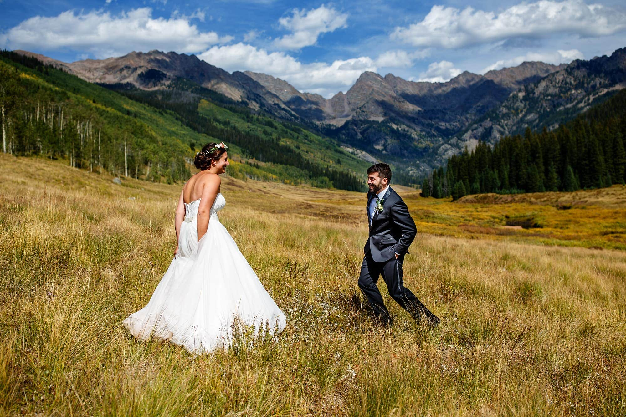 Becky and Brian share a moment during their first look at Piney River Ranch in front of the Gore mountain range.