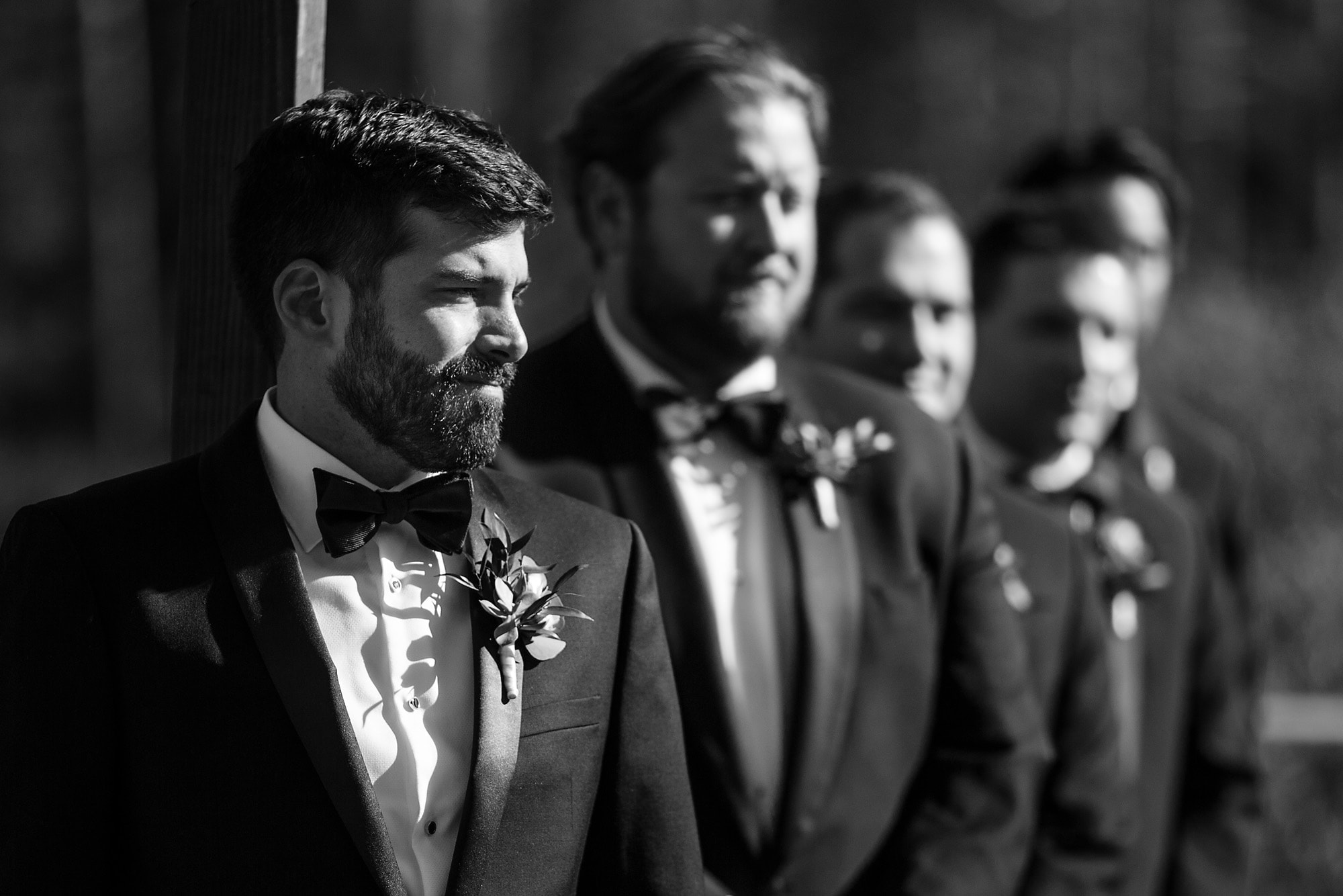 The groom sees his bride walk down the aisle.