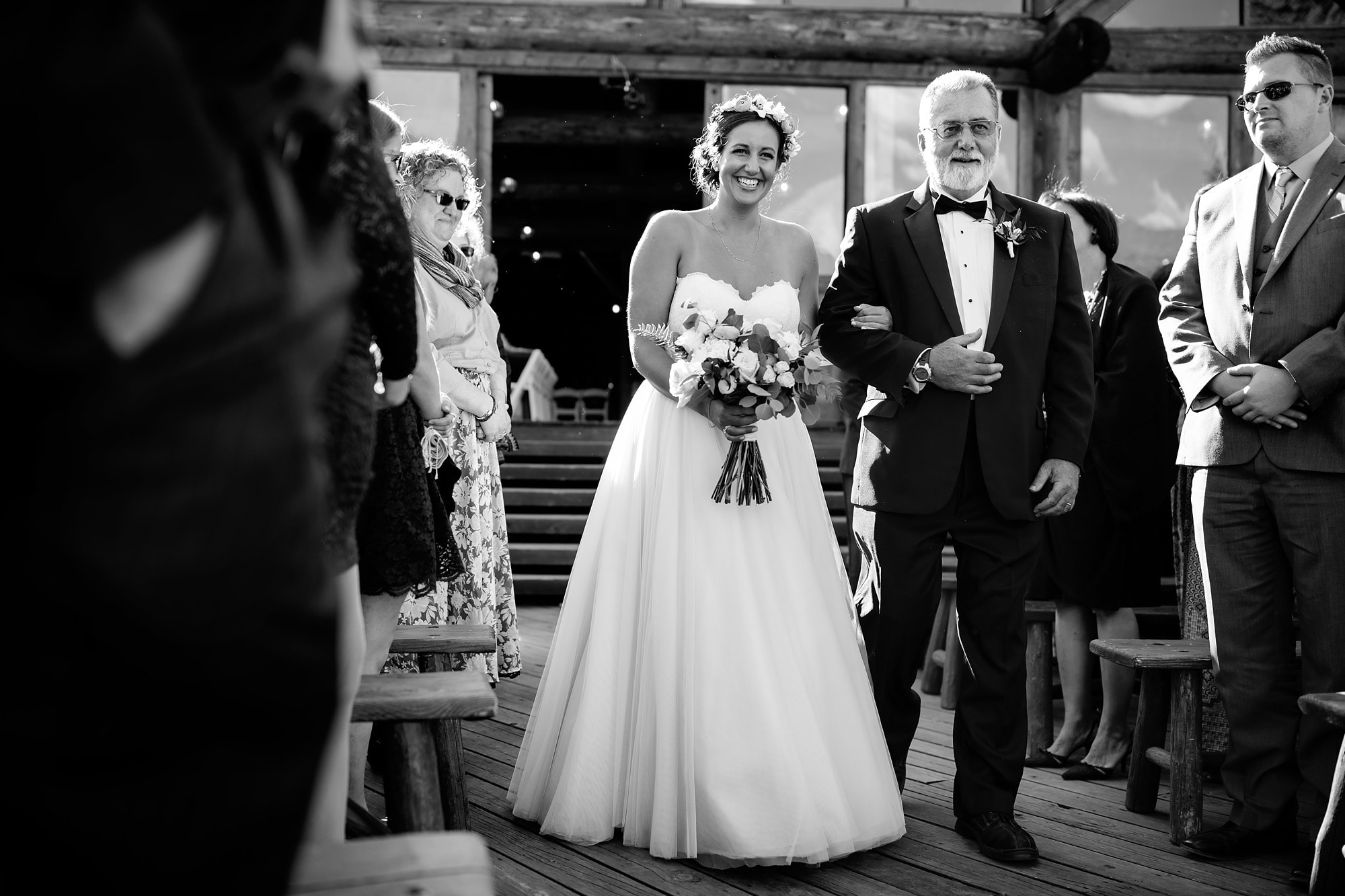 Becky and her father walk down the aisle at Piney River Ranch outside of Vail, Colorado.