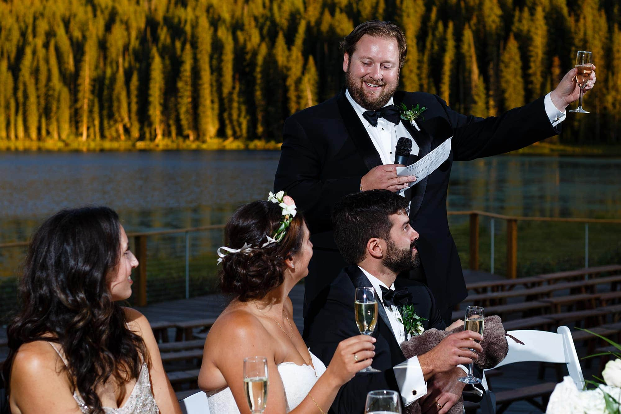 The best man toasts to the bride and groom during the reception.