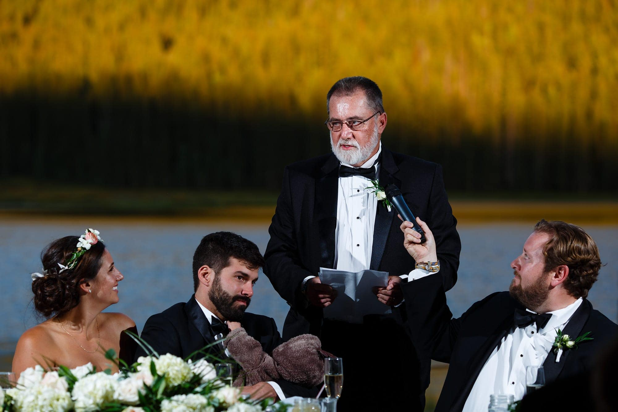 The Father of the bride gives a speech during the reception at Piney River Ranch.