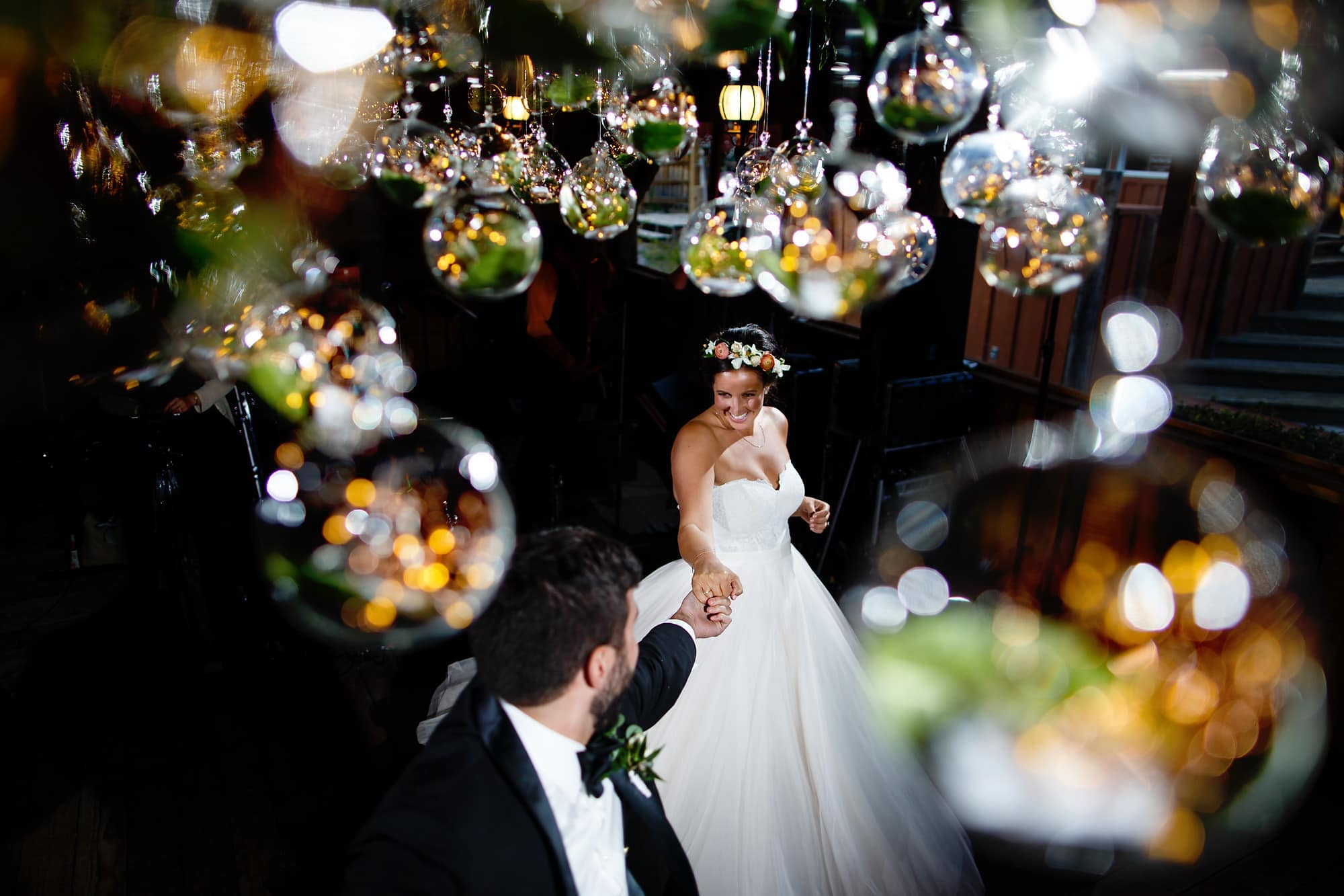 The Bride and groom share their first dance surrounded by glass globes at the reception at Piney River Ranch near Vail, Colorado.