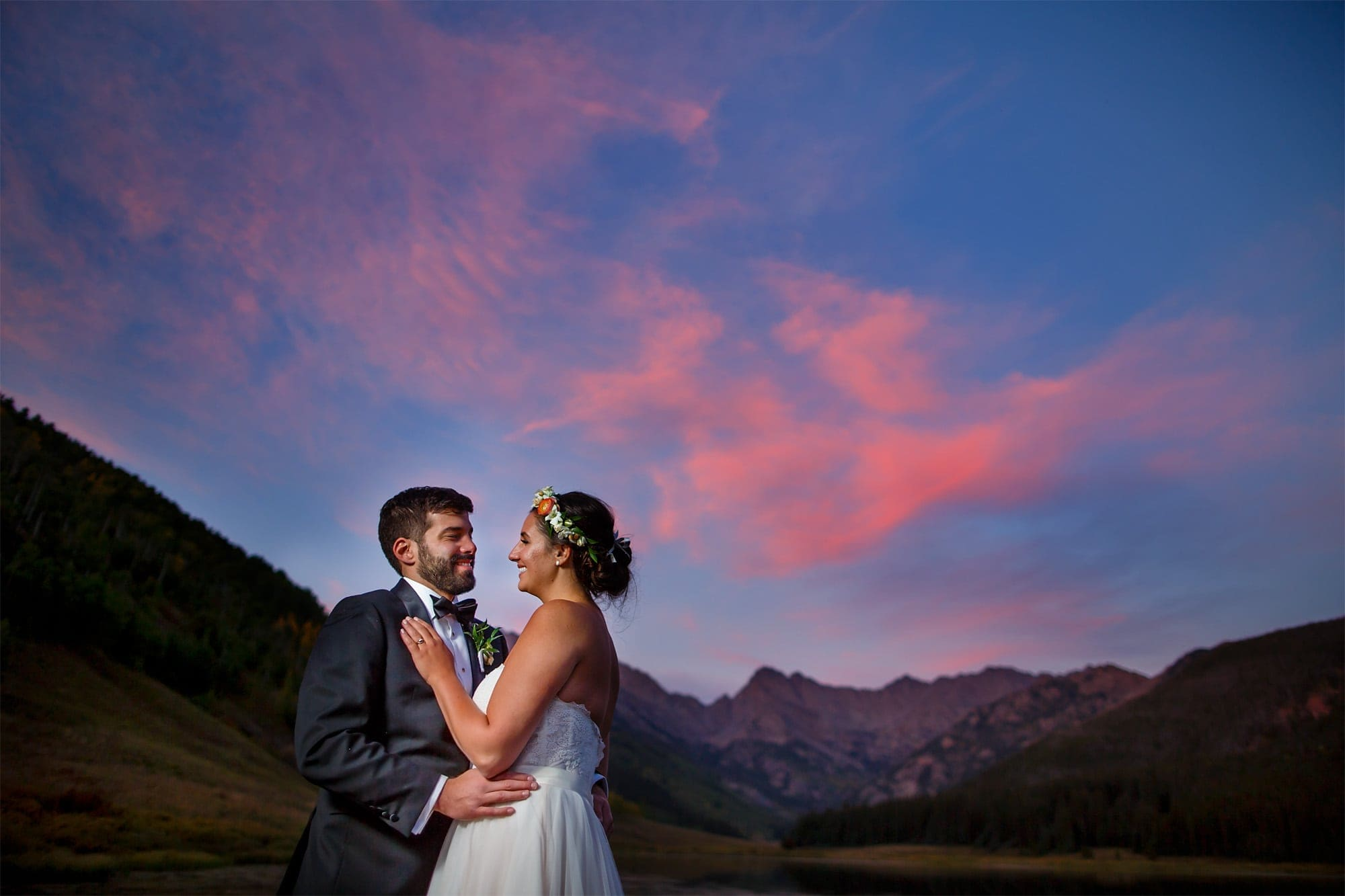 Becky and Brian share a moment together as the sunset lights up the sky above the Gore mountain range at Piney River Ranch in September outside of Vail, Colorado.