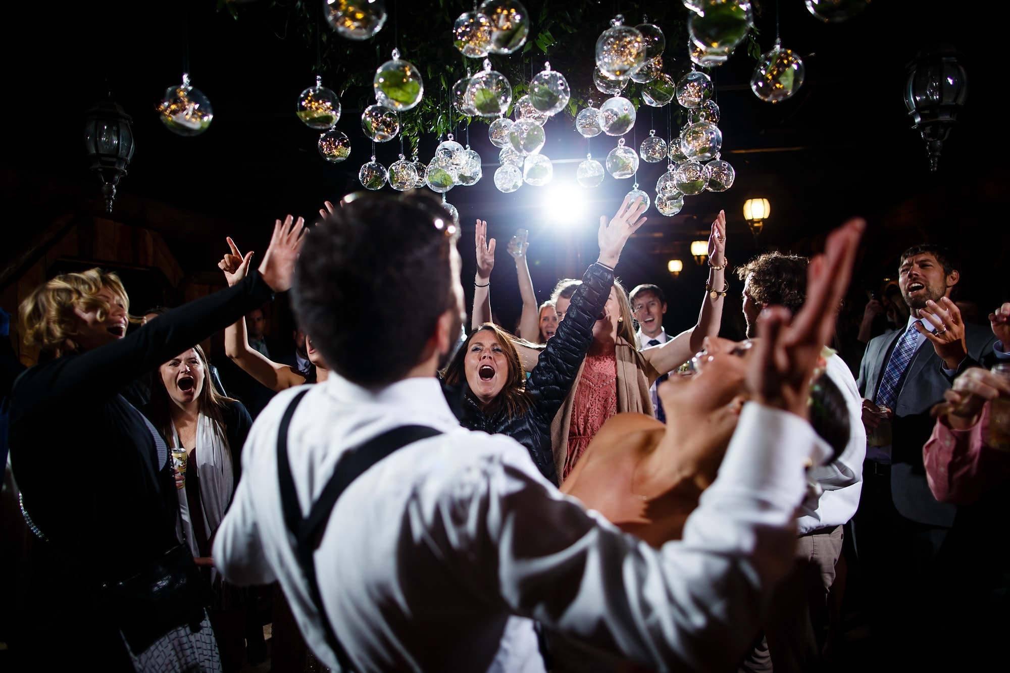 Guests dance during the reception at Piney River Ranch near Vail, Colorado.