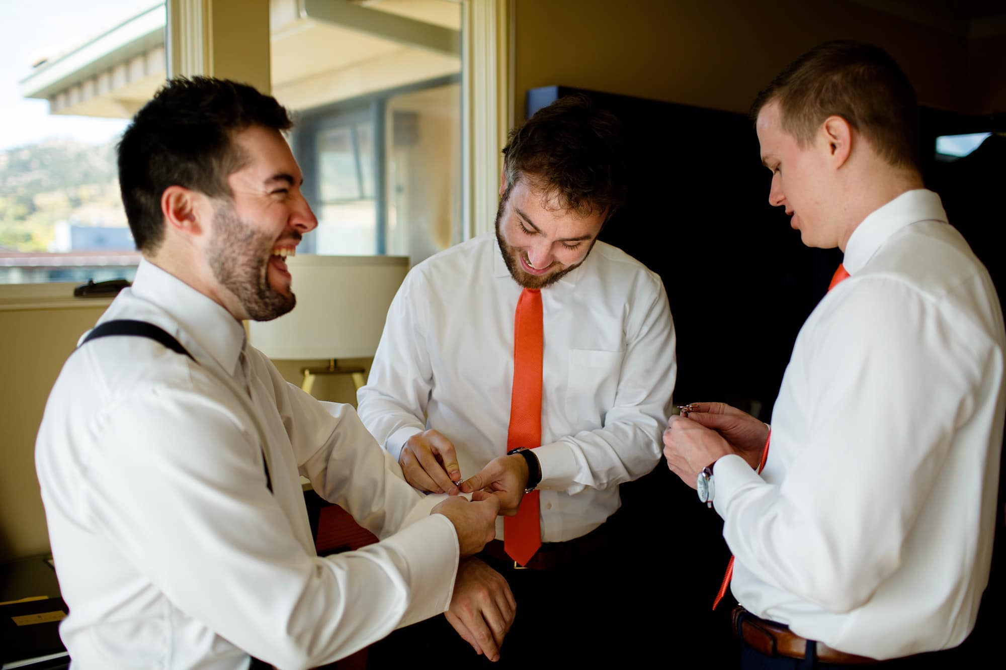 Bryan shares a laugh with his groomsmen while getting ready at the St. Julien Hotel in Boulder