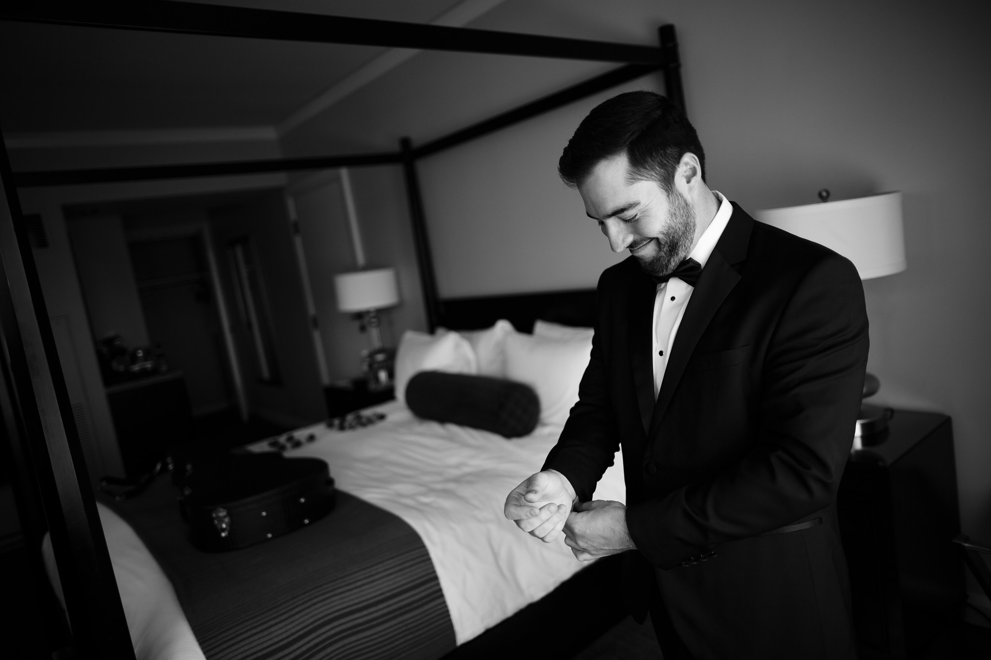 The groom adjusts his jacket while getting ready at the St. Julien Hotel in Boulder