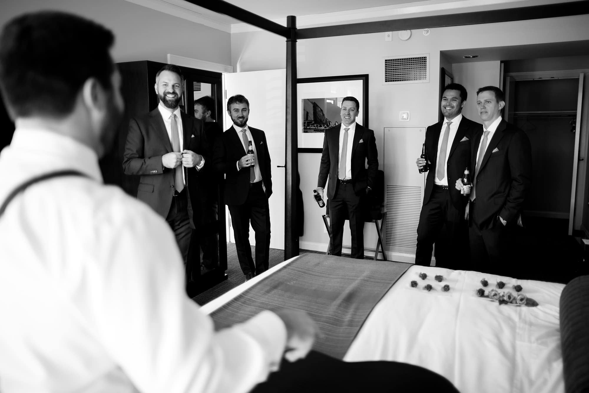 Bryan shares a laugh with his groomsmen at the St. Julien Hotel in Boulder