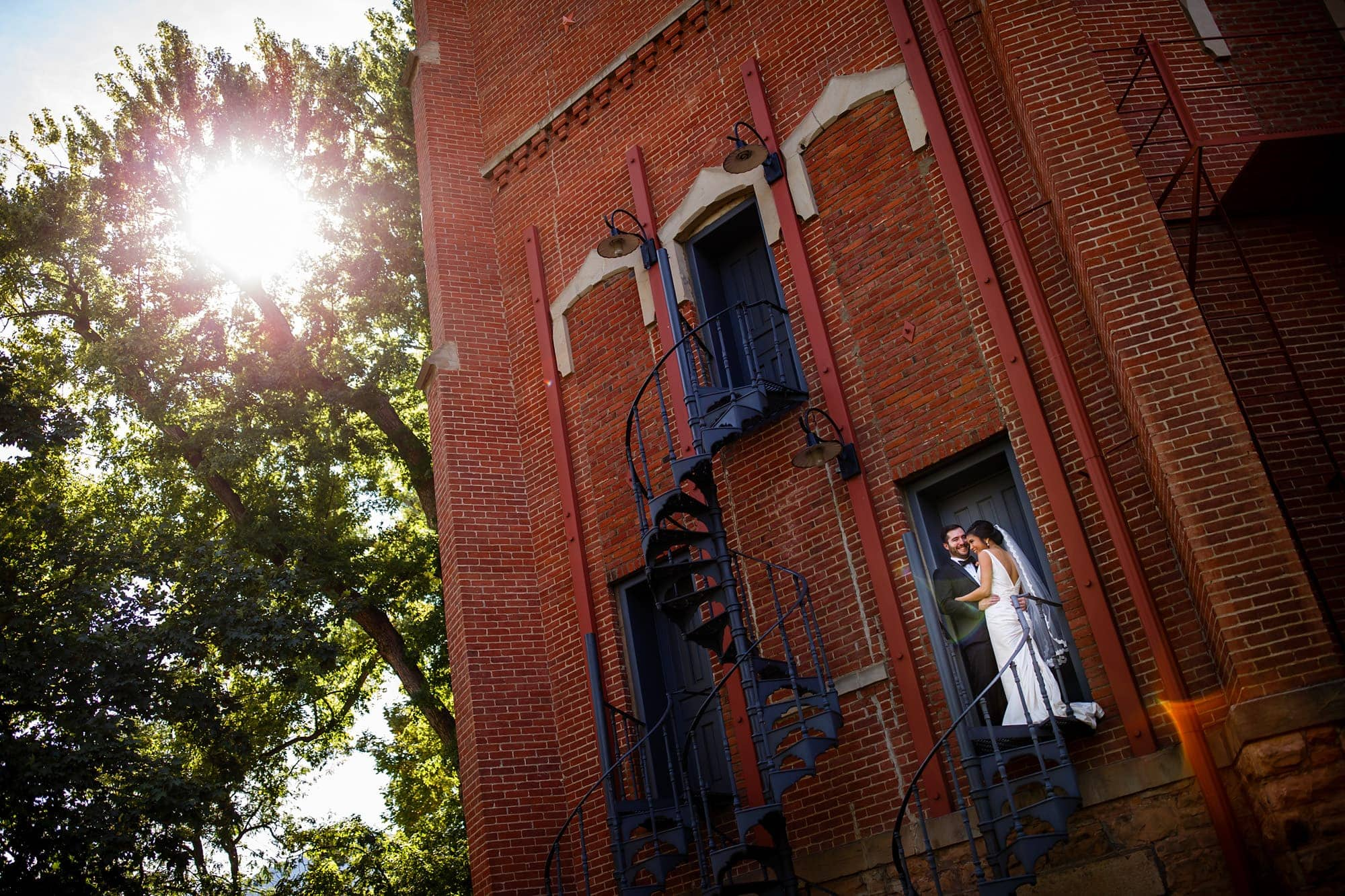Megan and Bryan pose on the staircase of Old Main on the University of Colorado campus before their wedding