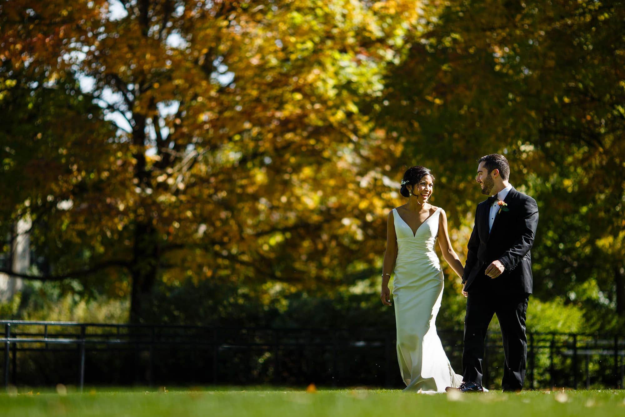 Megan and Bryan walk on Norlin Quad on the University of Colorado campus before their wedding