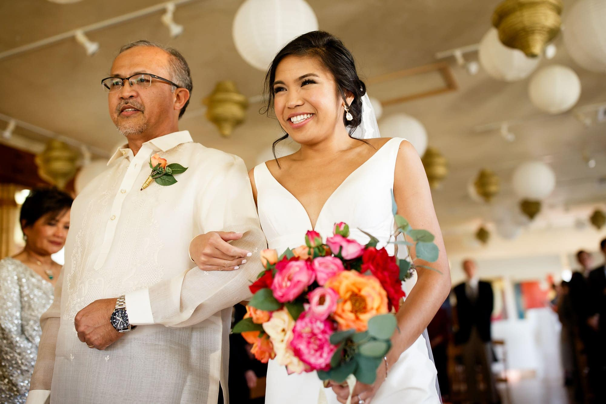 Megan walks down the aisle with her father by her side during her wedding at Rembrandt Yard