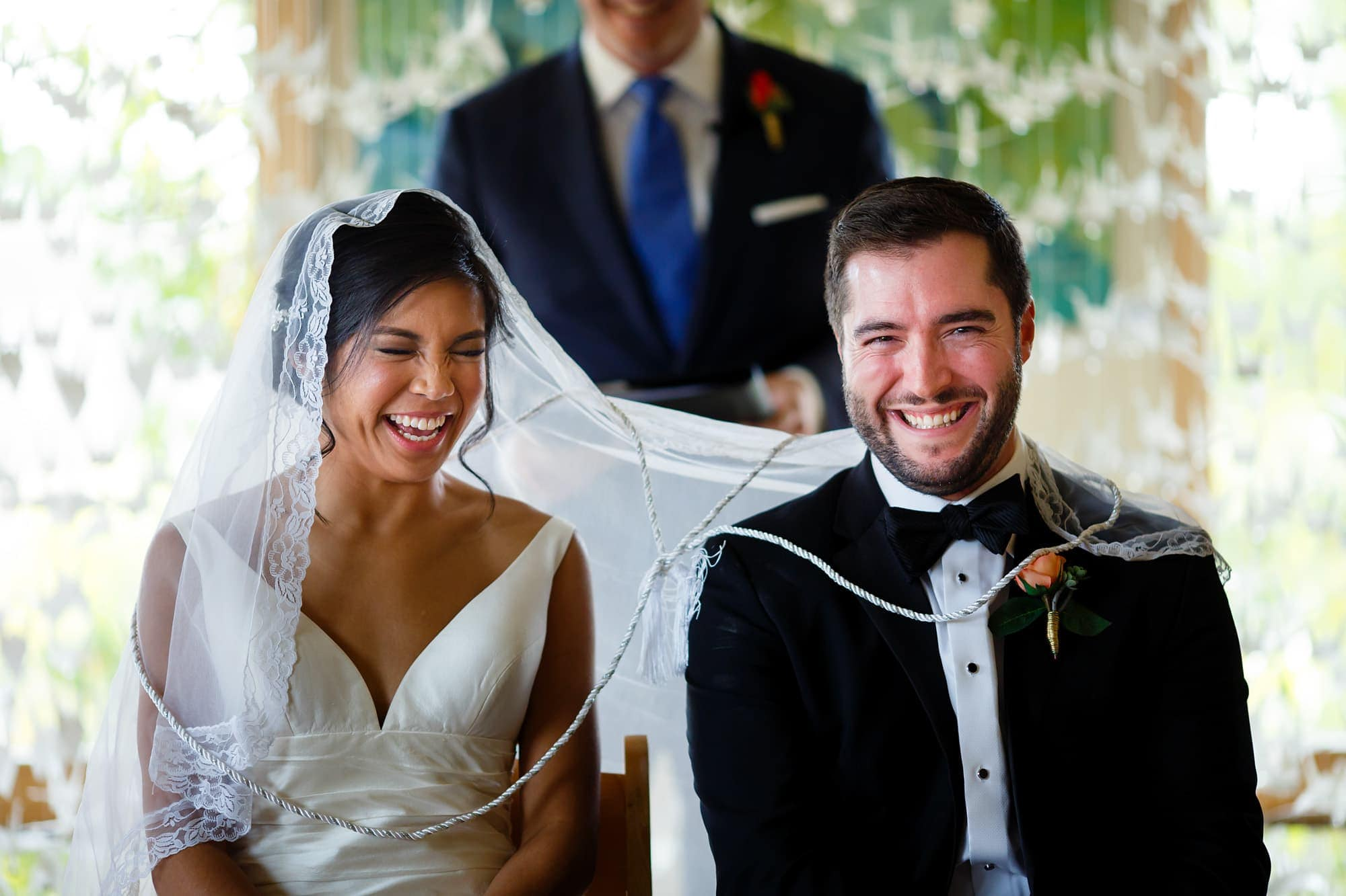 Bryan and Megan participate in the veil and cord ceremony during their Rembrandt Yard wedding