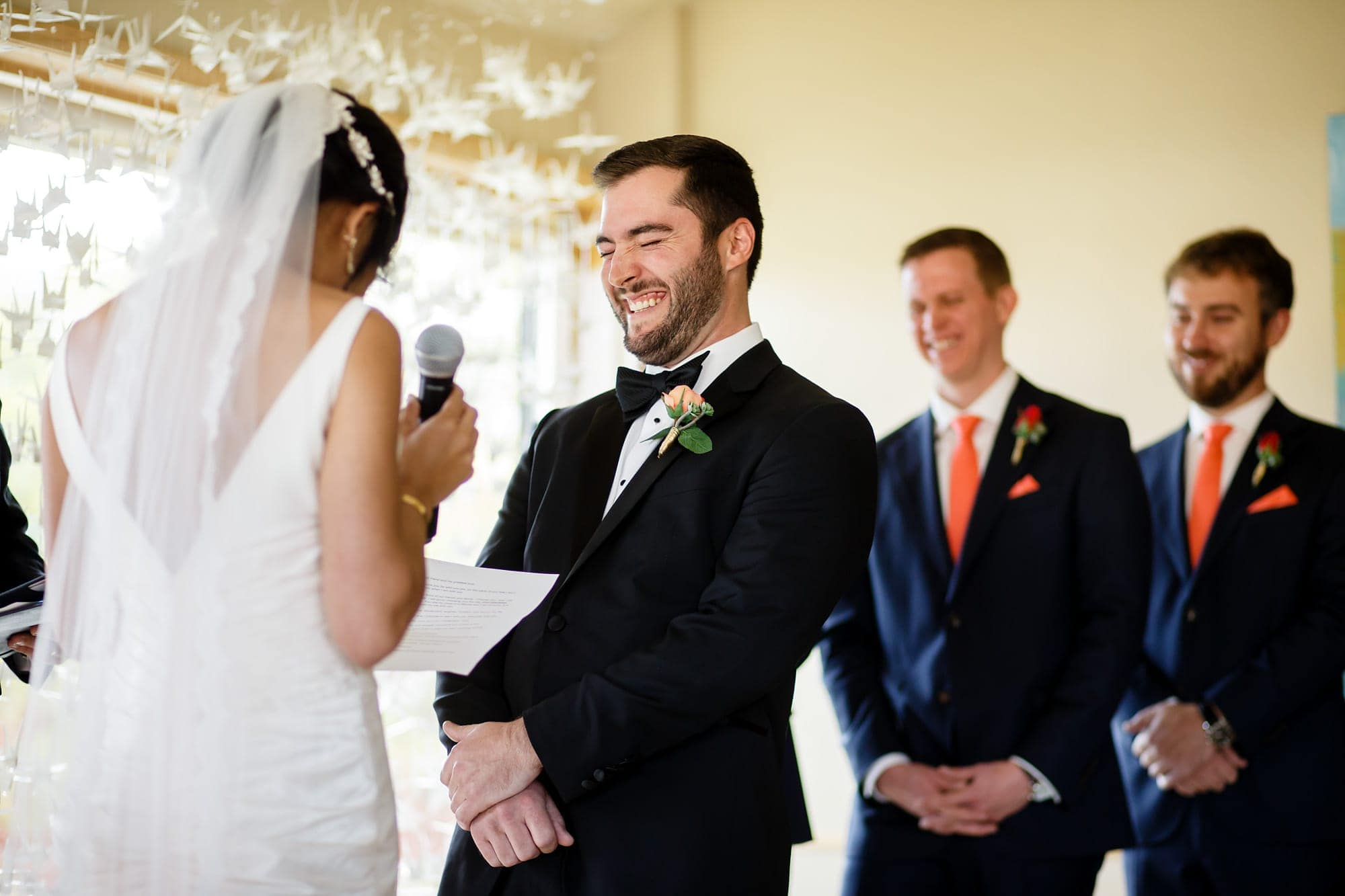 Bryan laughs during Megan's vows