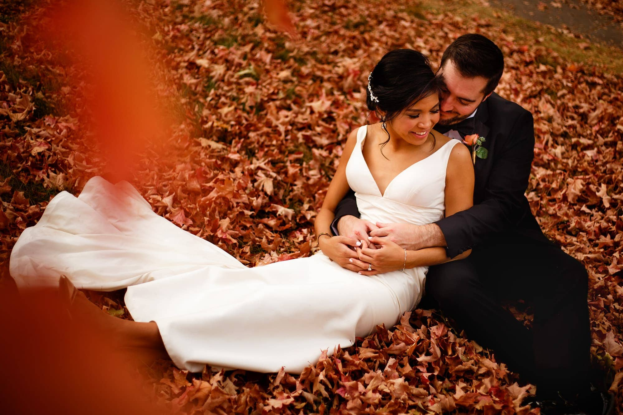 The couple sits in a pile of maple trees in Boulder, Colorado
