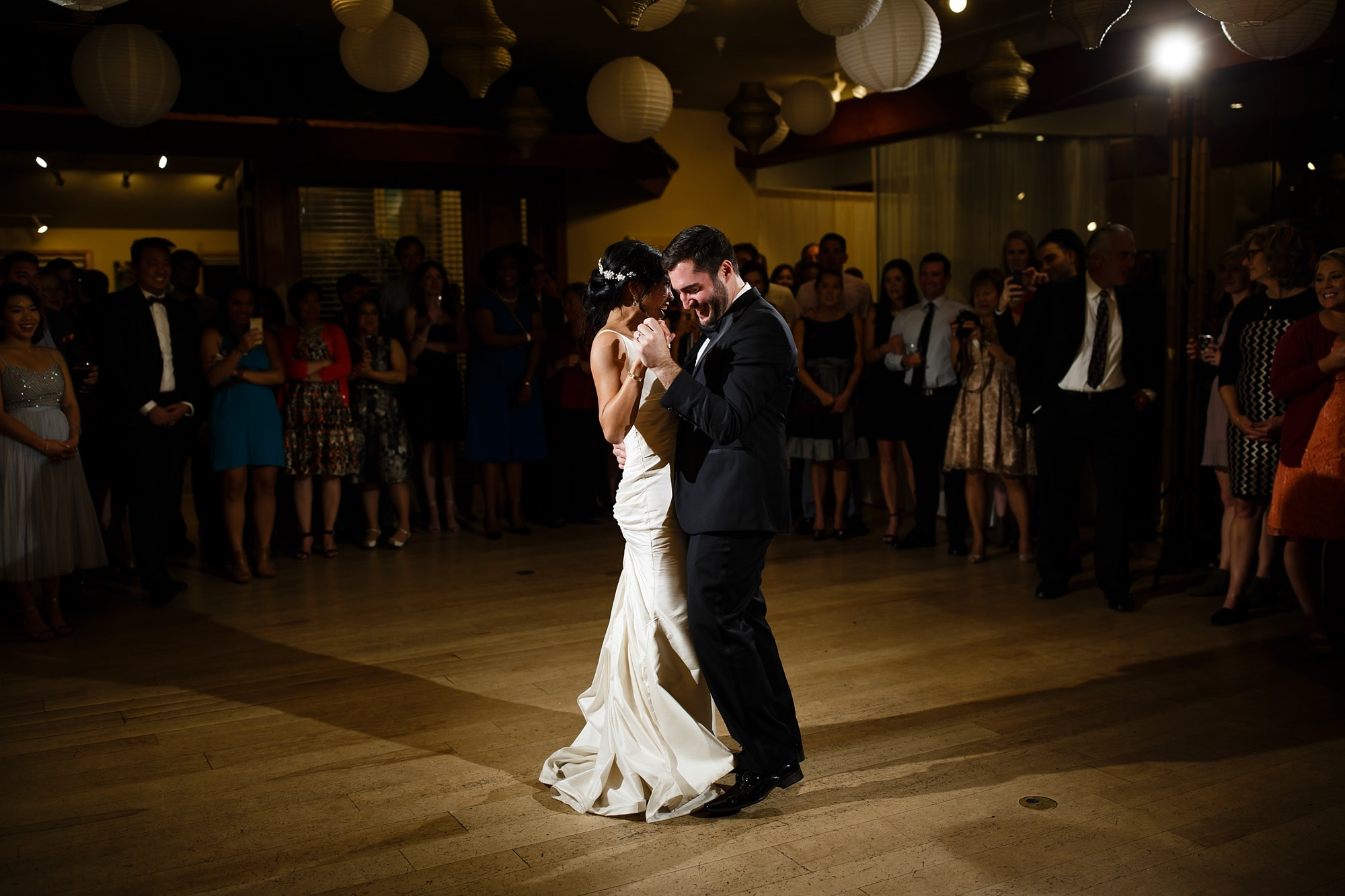 The bride and groom share their first dance on the third floor at Rembrandt Yard during their wedding reception