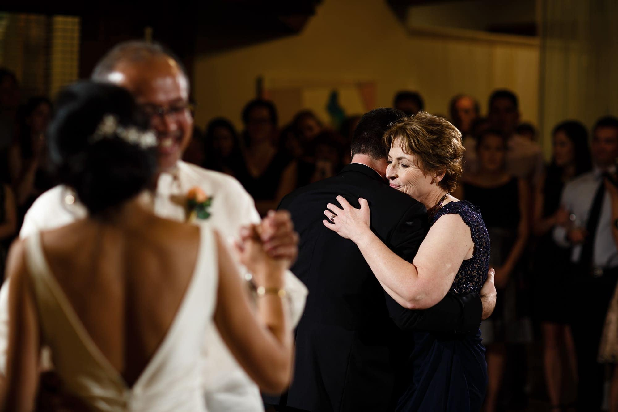 Parents dance with the happy couple