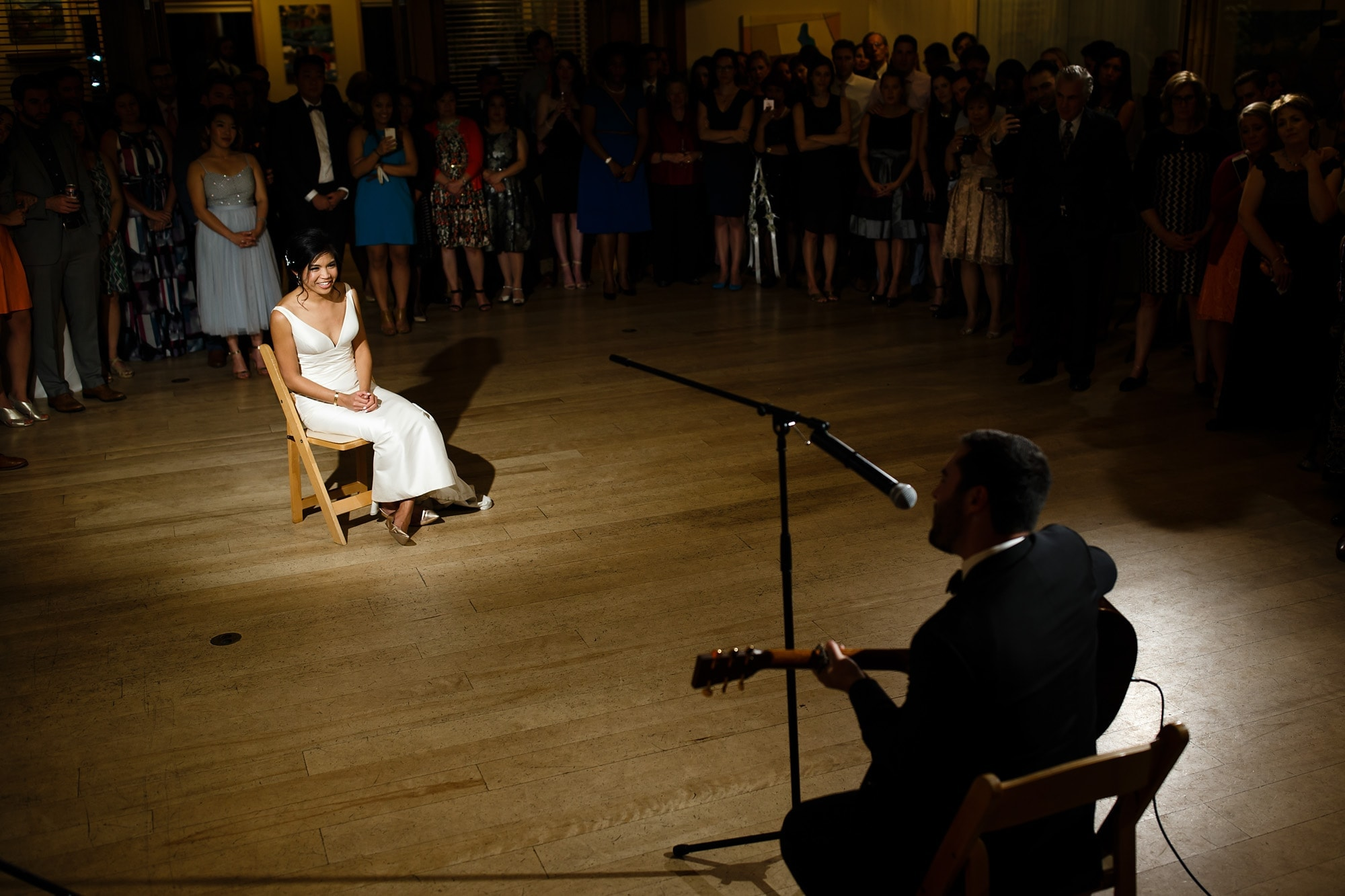 Bryan performs a song for his bride during their wedding at Rembrandt Yard