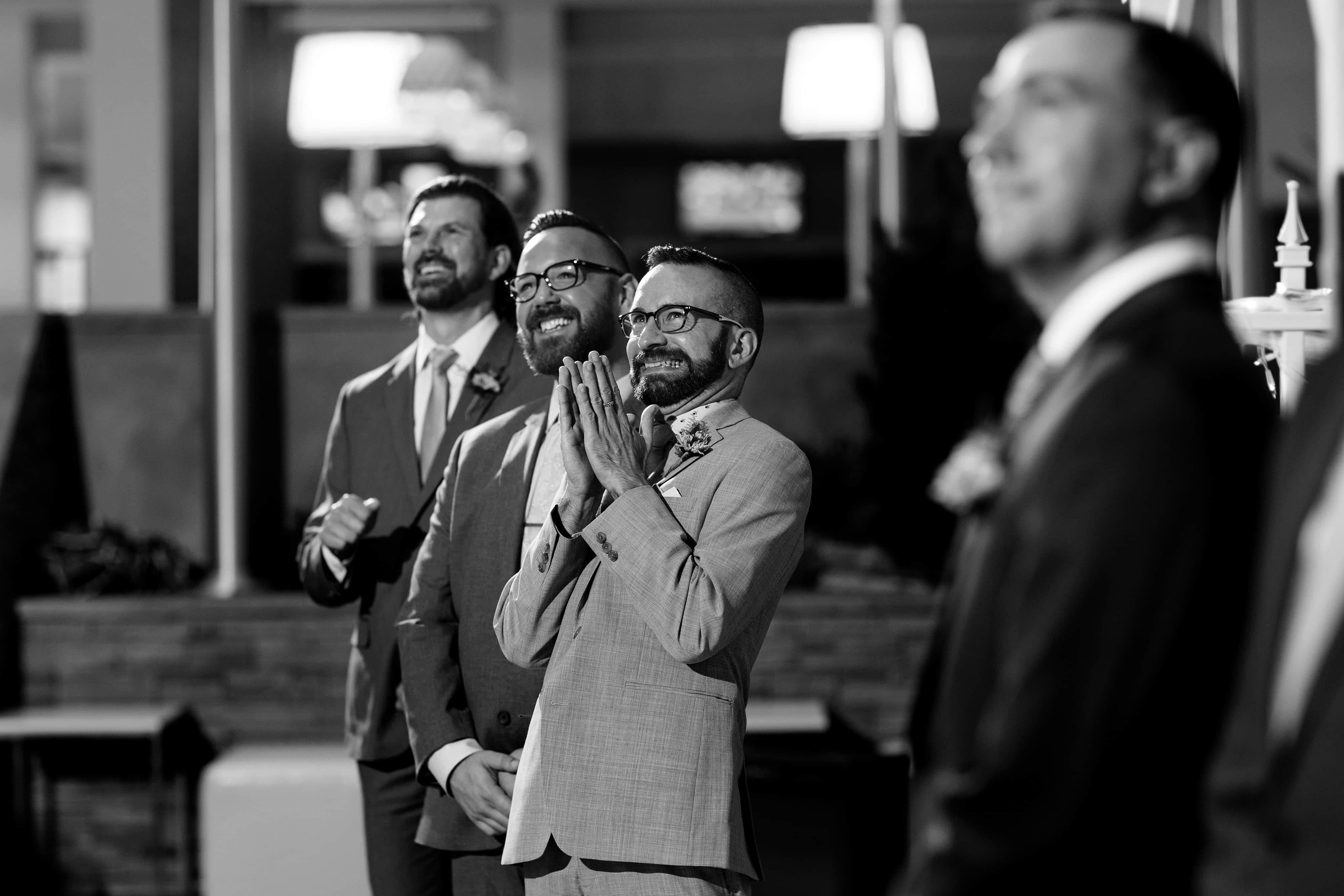 The Brosmaids React As They Watch The Bride Walk Down The