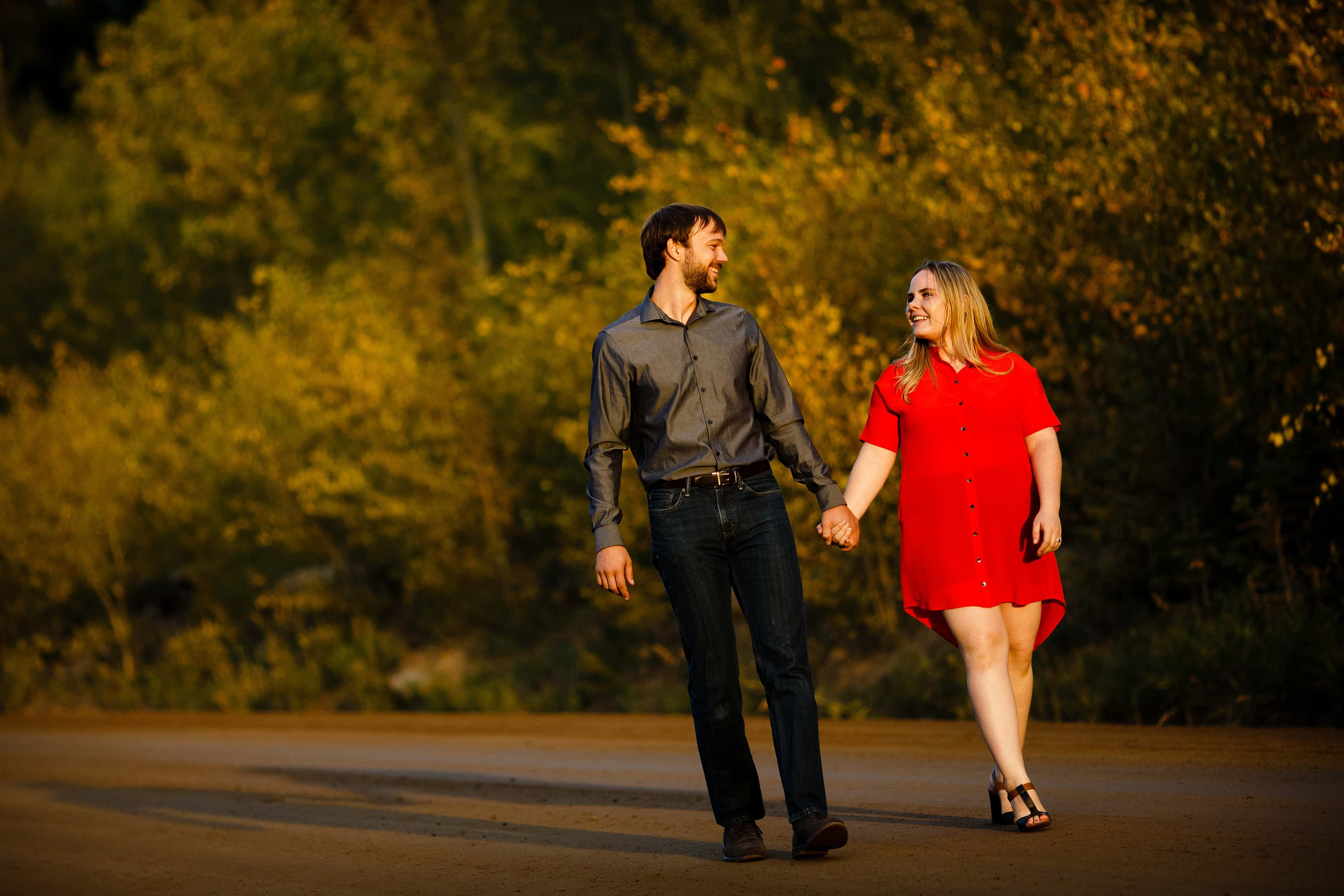 The couple walks along Gap road during their fall Golden engagement