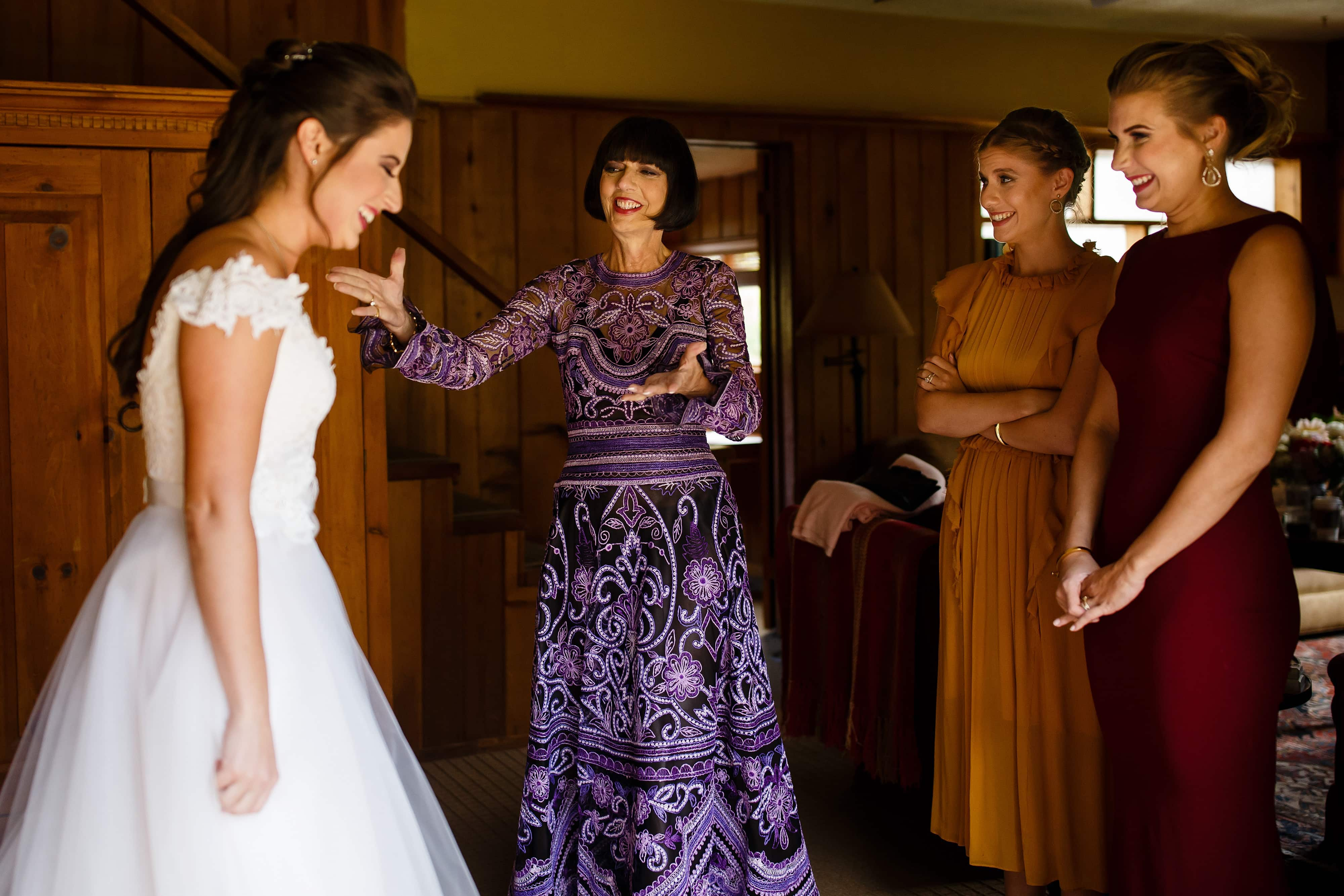 Mallory's mother and sisters react to seing her in her dress before the wedding at Snowmass Cottages