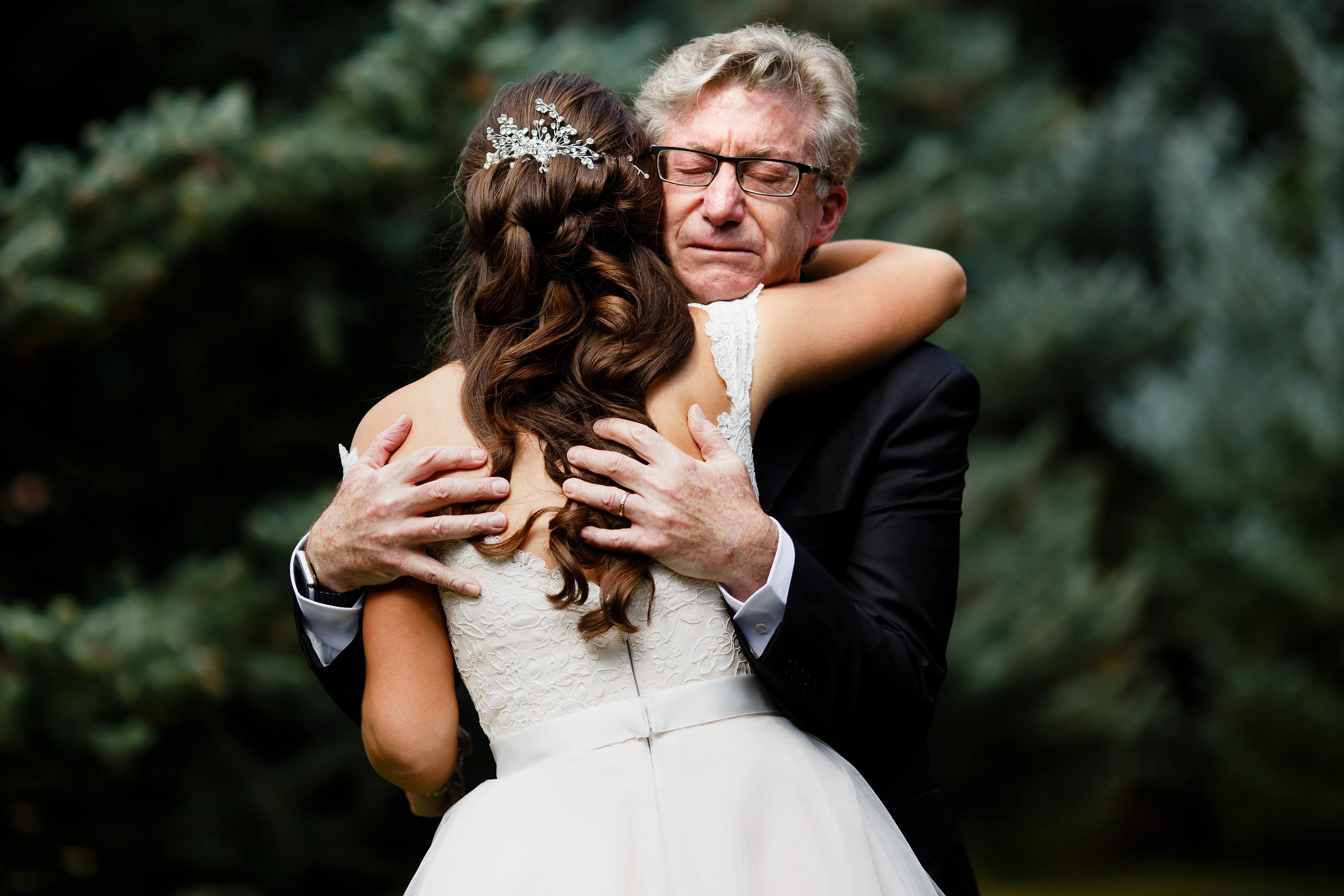Richard embraces his daughter after seeing her in her gown for the first time on her wedding day