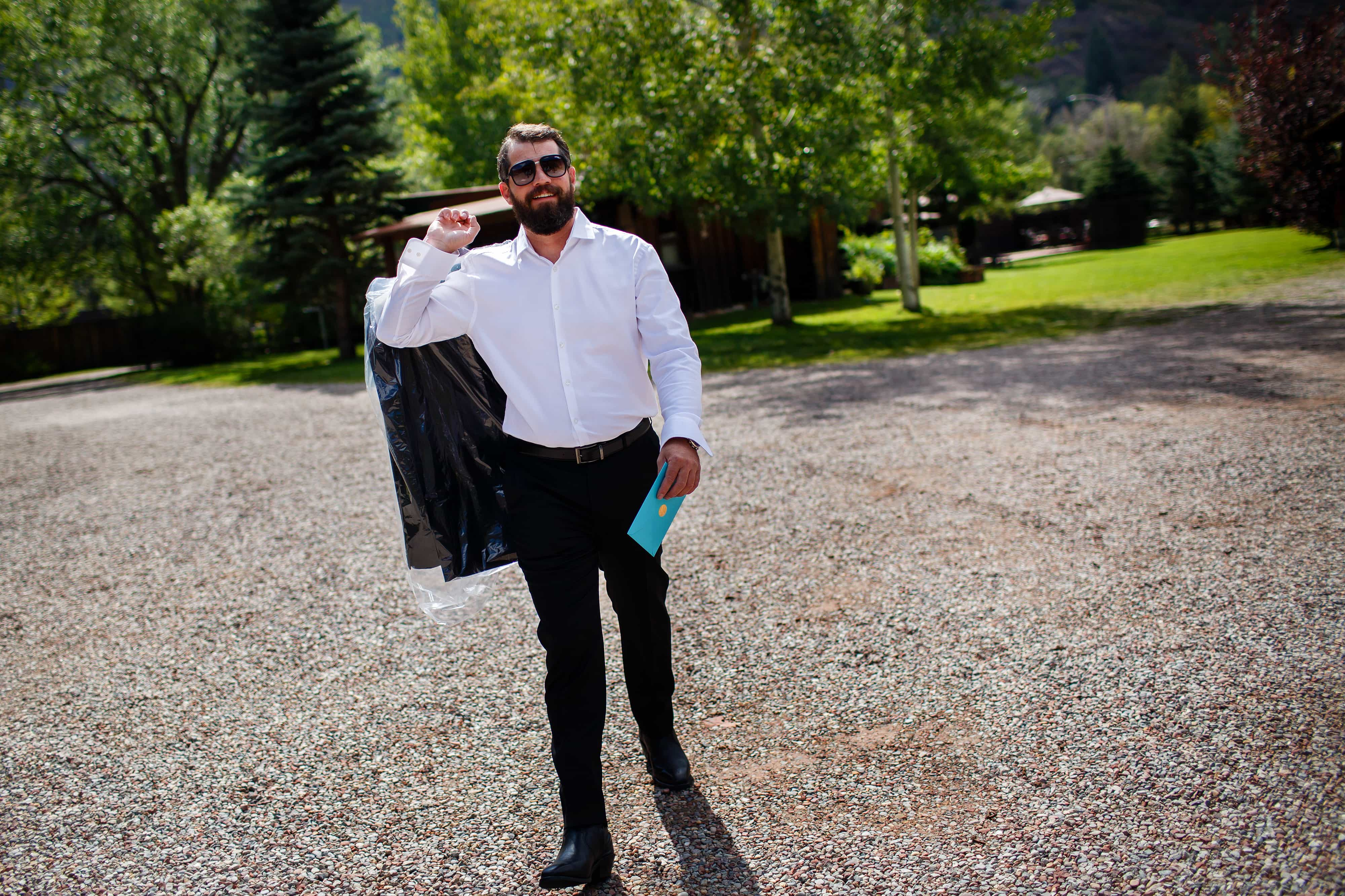 The groom arrives at Snowmass Cottages for his wedding