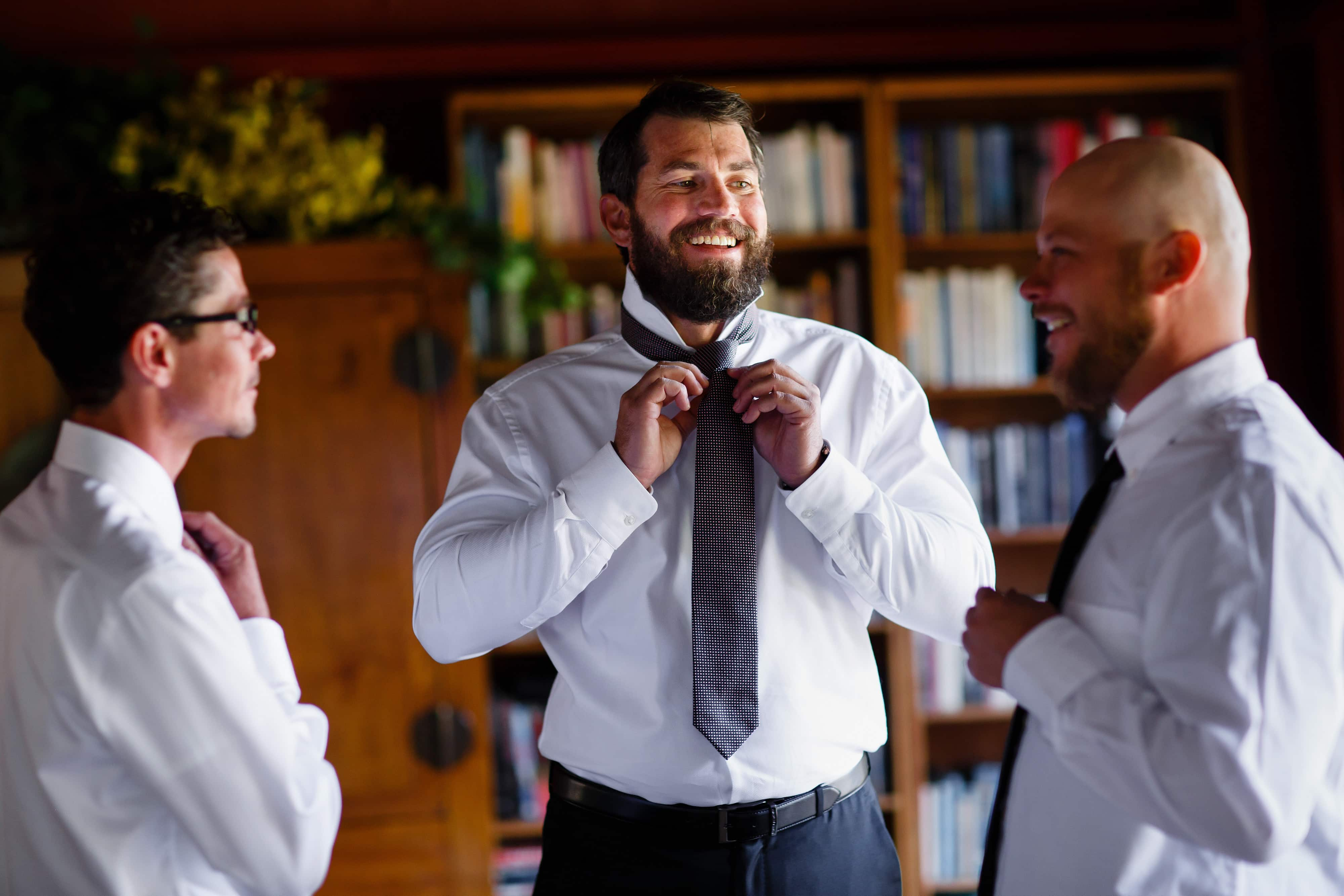The groom gets ready with his groomsmen in the welcome center at Snowmass Cottages
