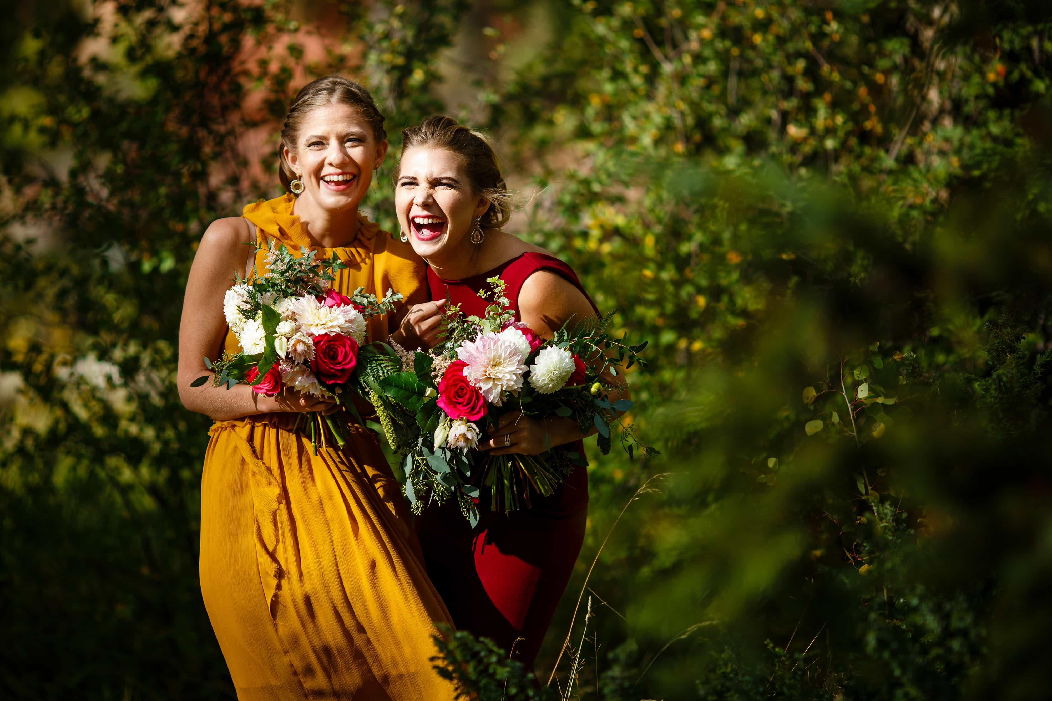 Sisters of the bride laugh together before the ceremony at Snowmass Cottages