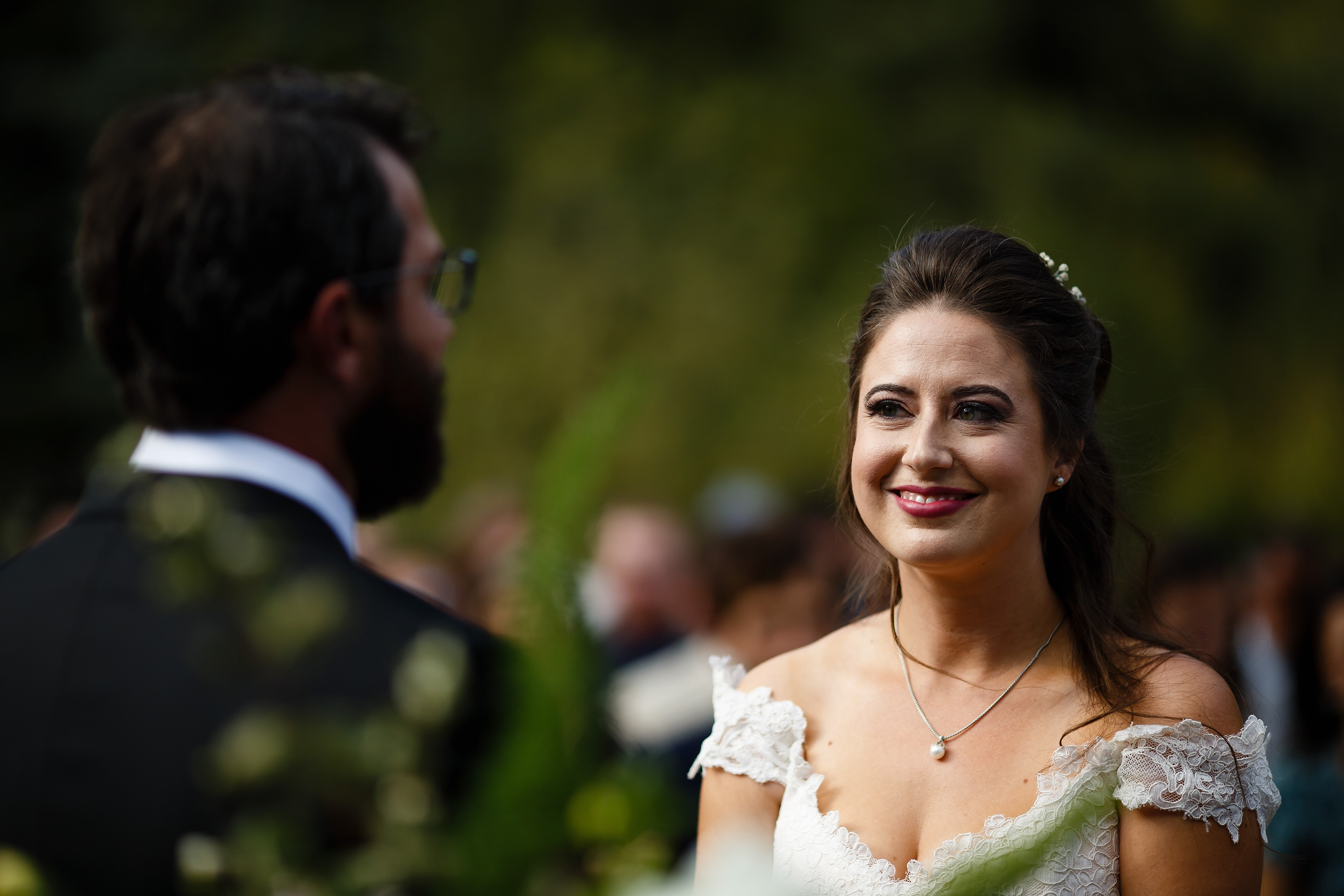Mallory looks at Daniel during their ceremony