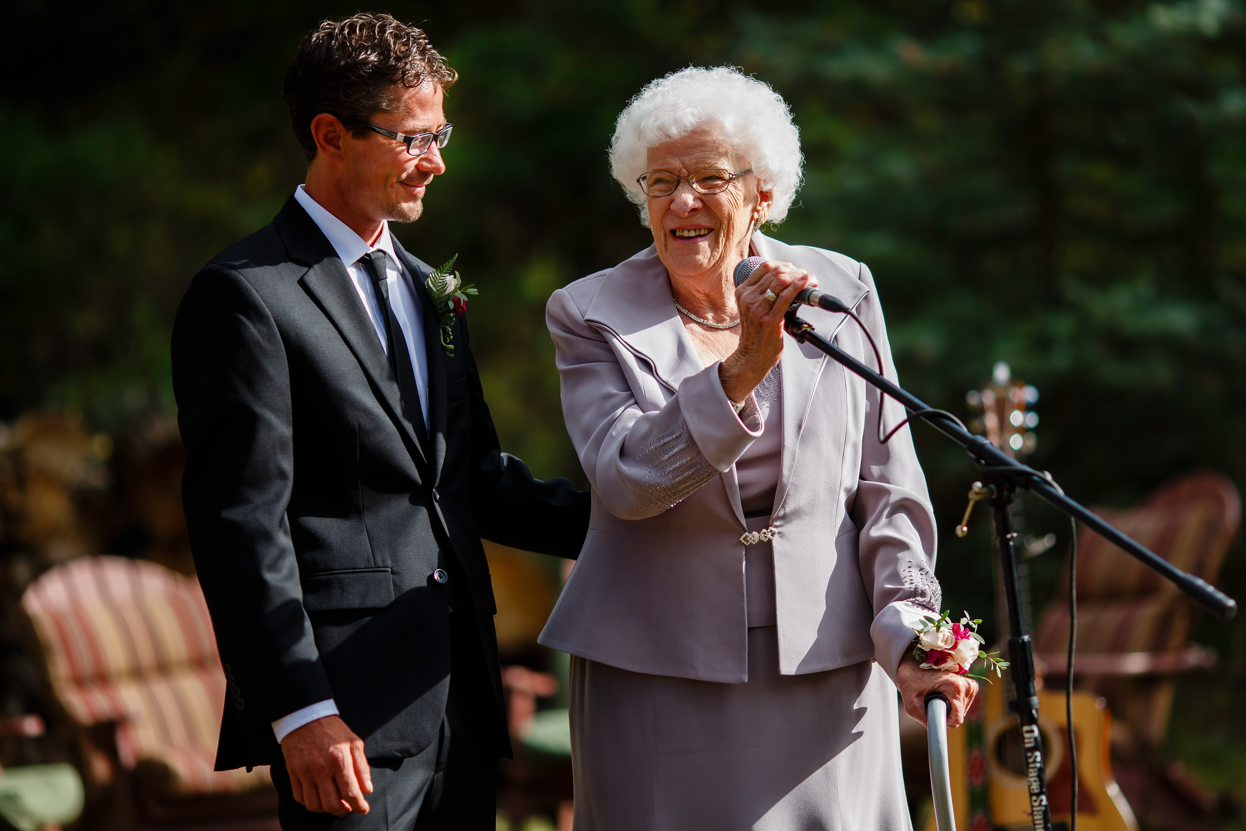 The grandmother speeks during the ceremony
