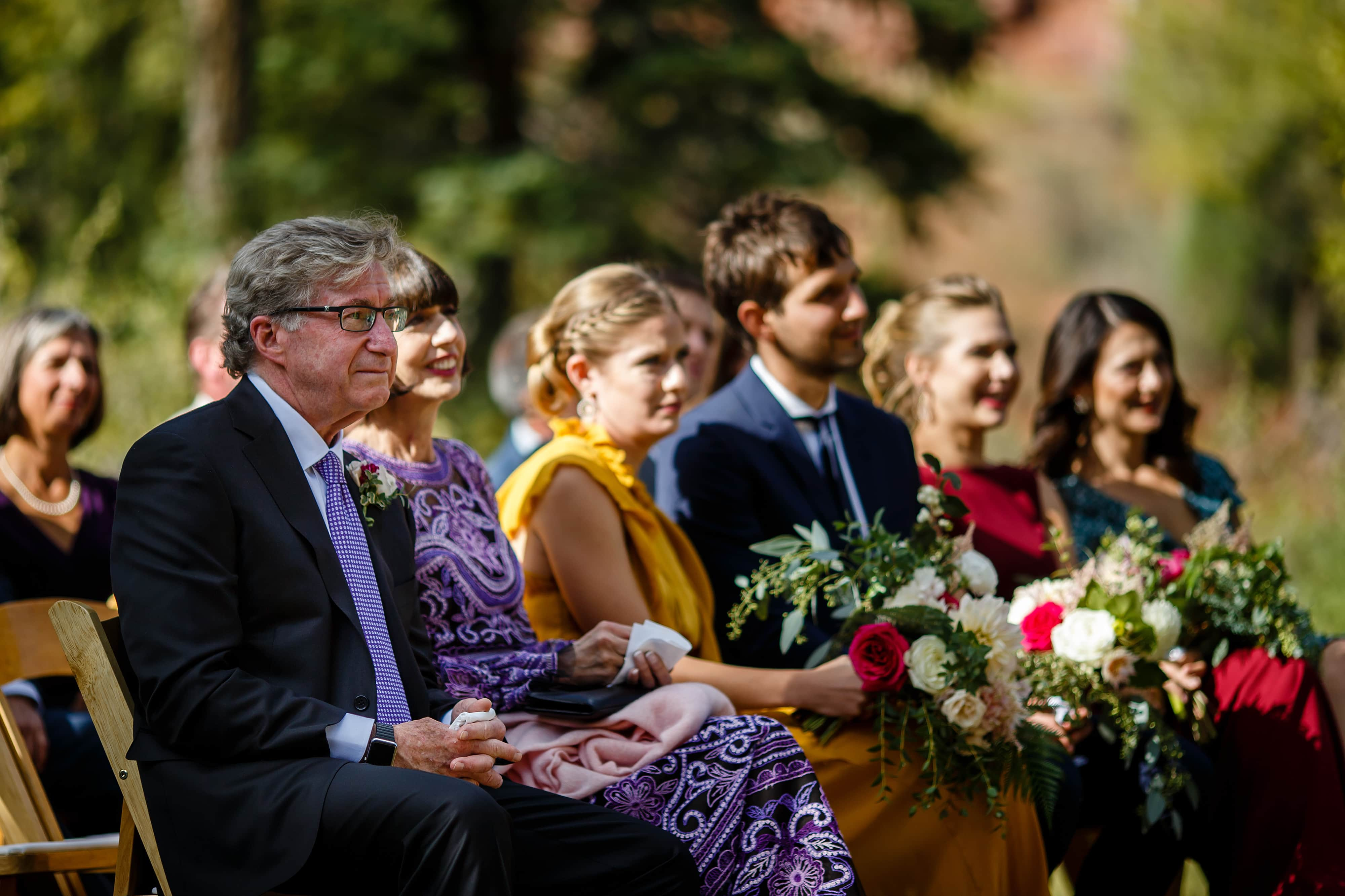 The brides family looks on during the ceremony