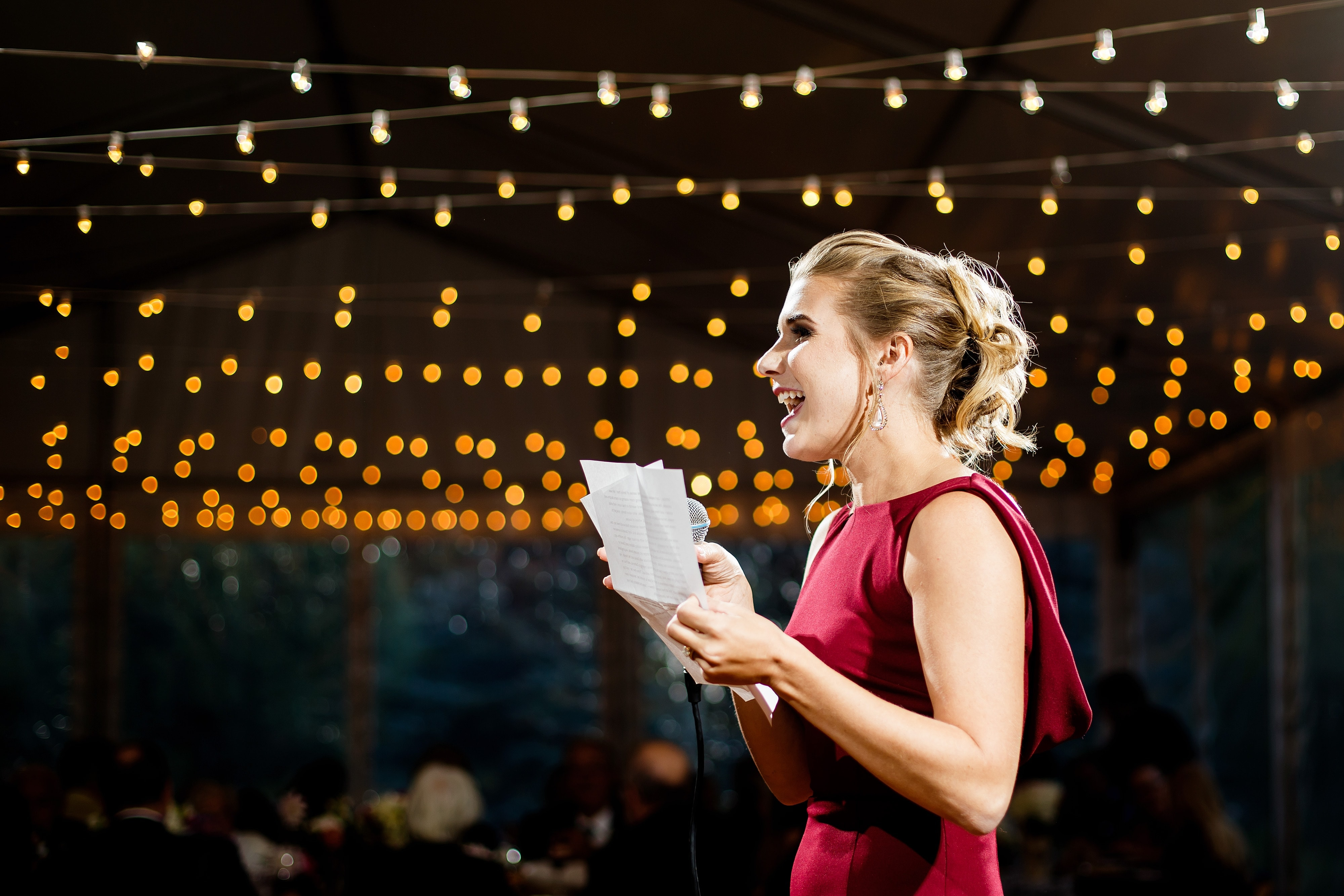 The sister of the bride gives a speech during the reception at Snowmass Cottages