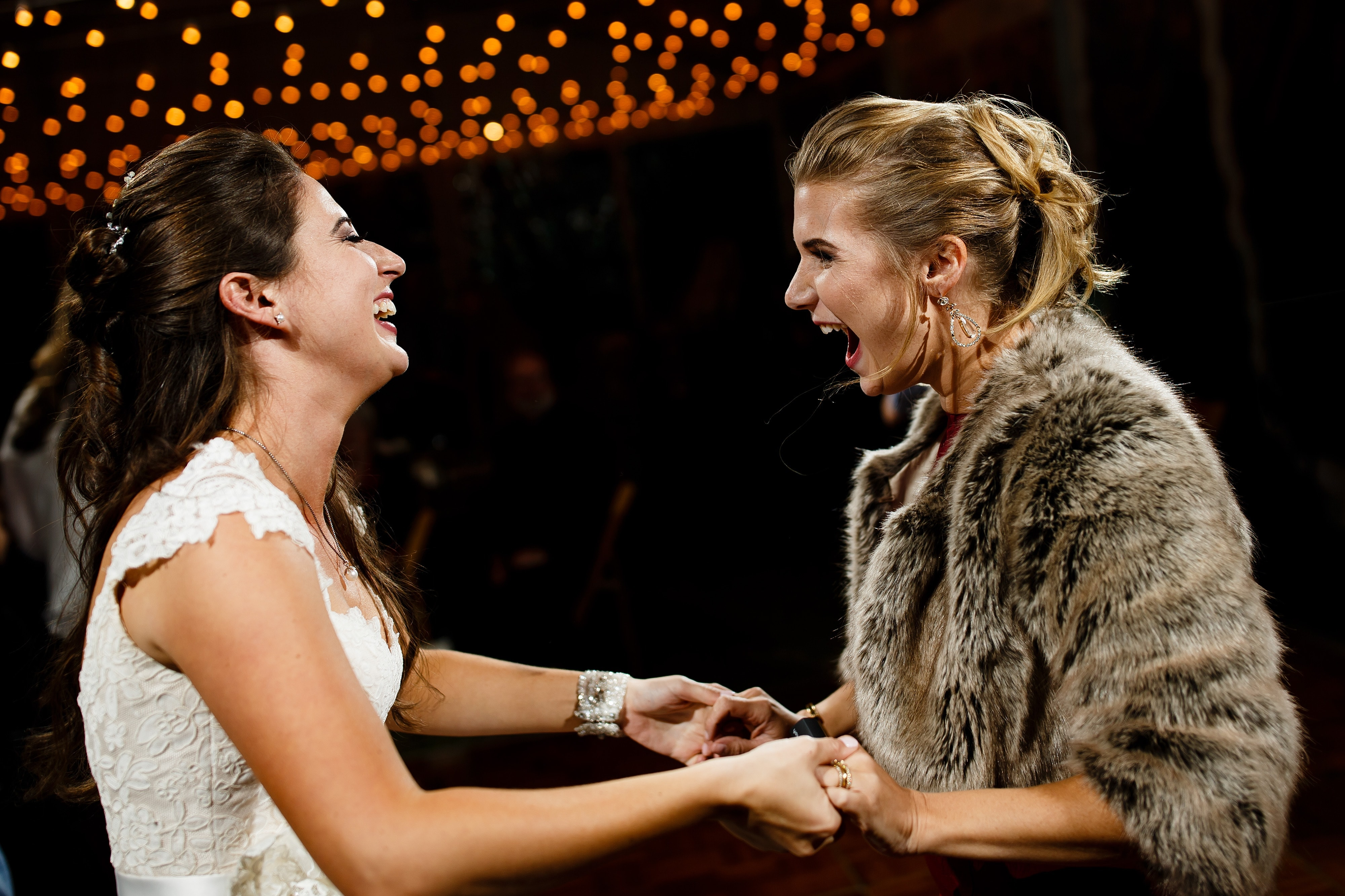 Mallory dances with her sister at their Snowmass Cottages wedding