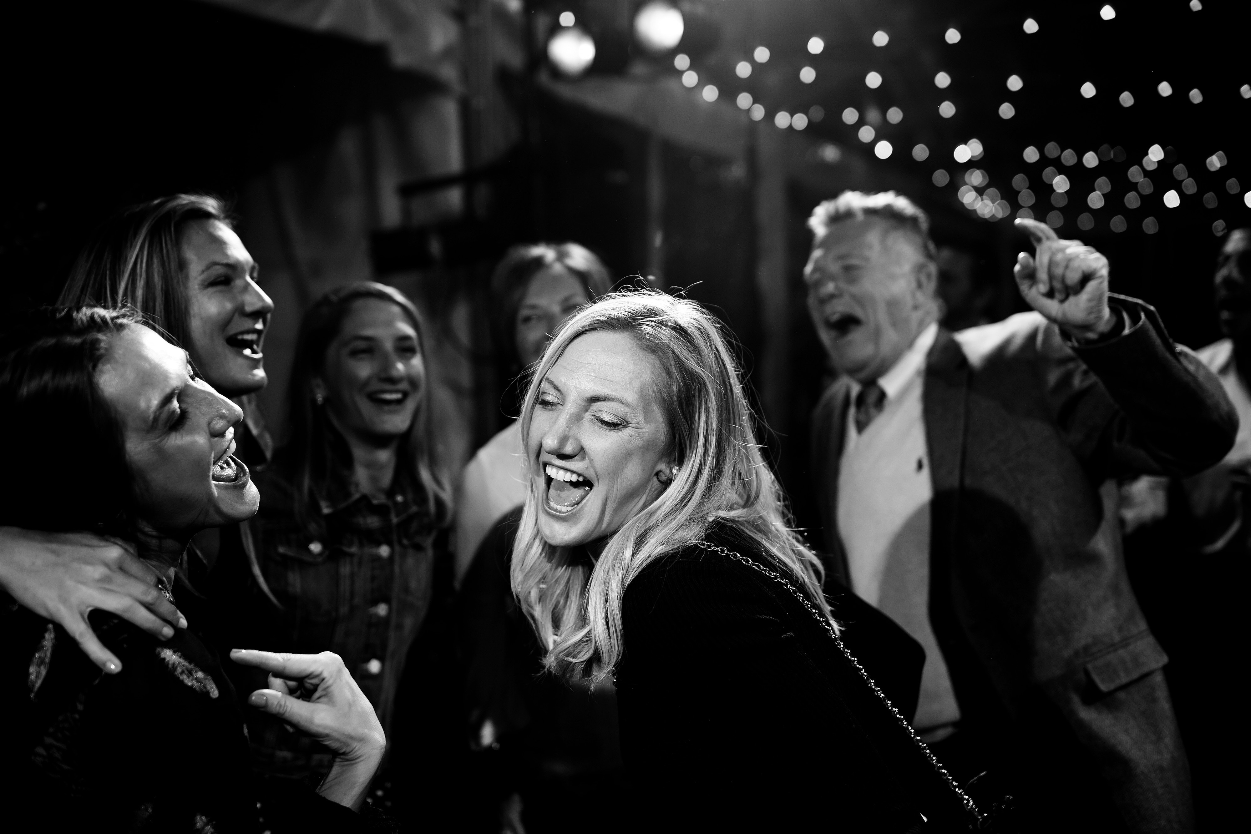 Wedding guests sing together at the Snowmass Cottages wedding reception