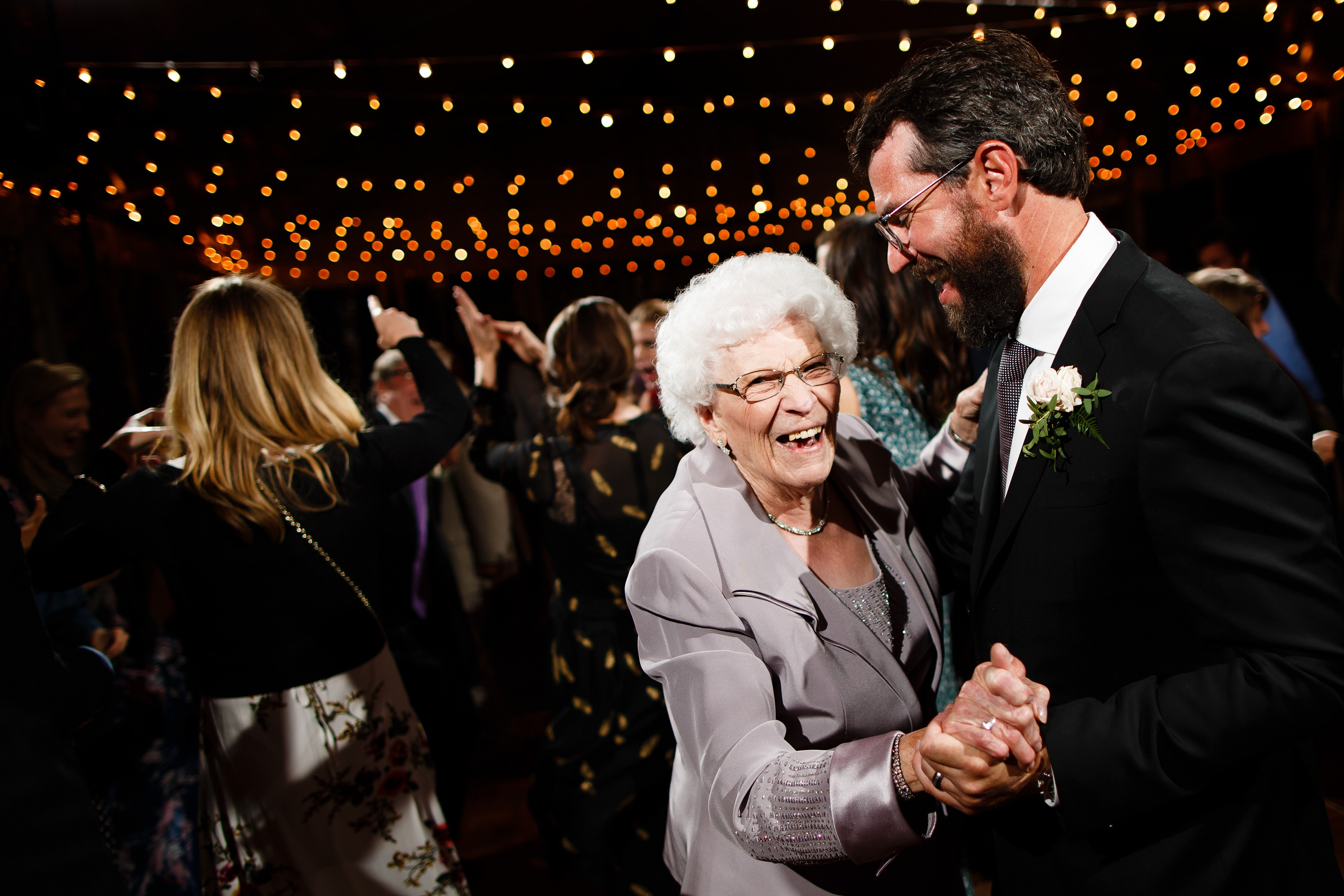 The groom dances with his grandmother