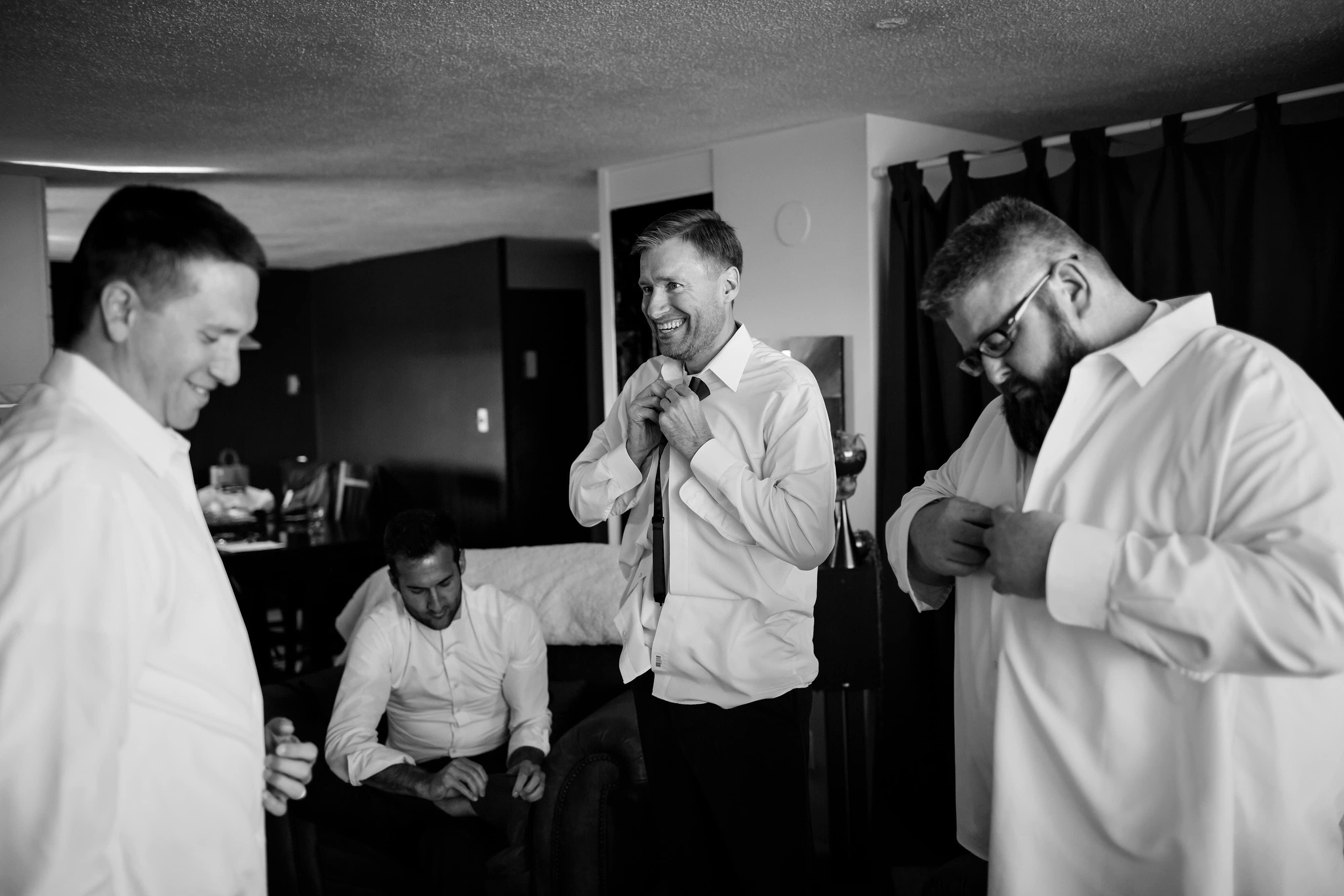 Ryan gets ready with his groomsmen at the Westin in Denver