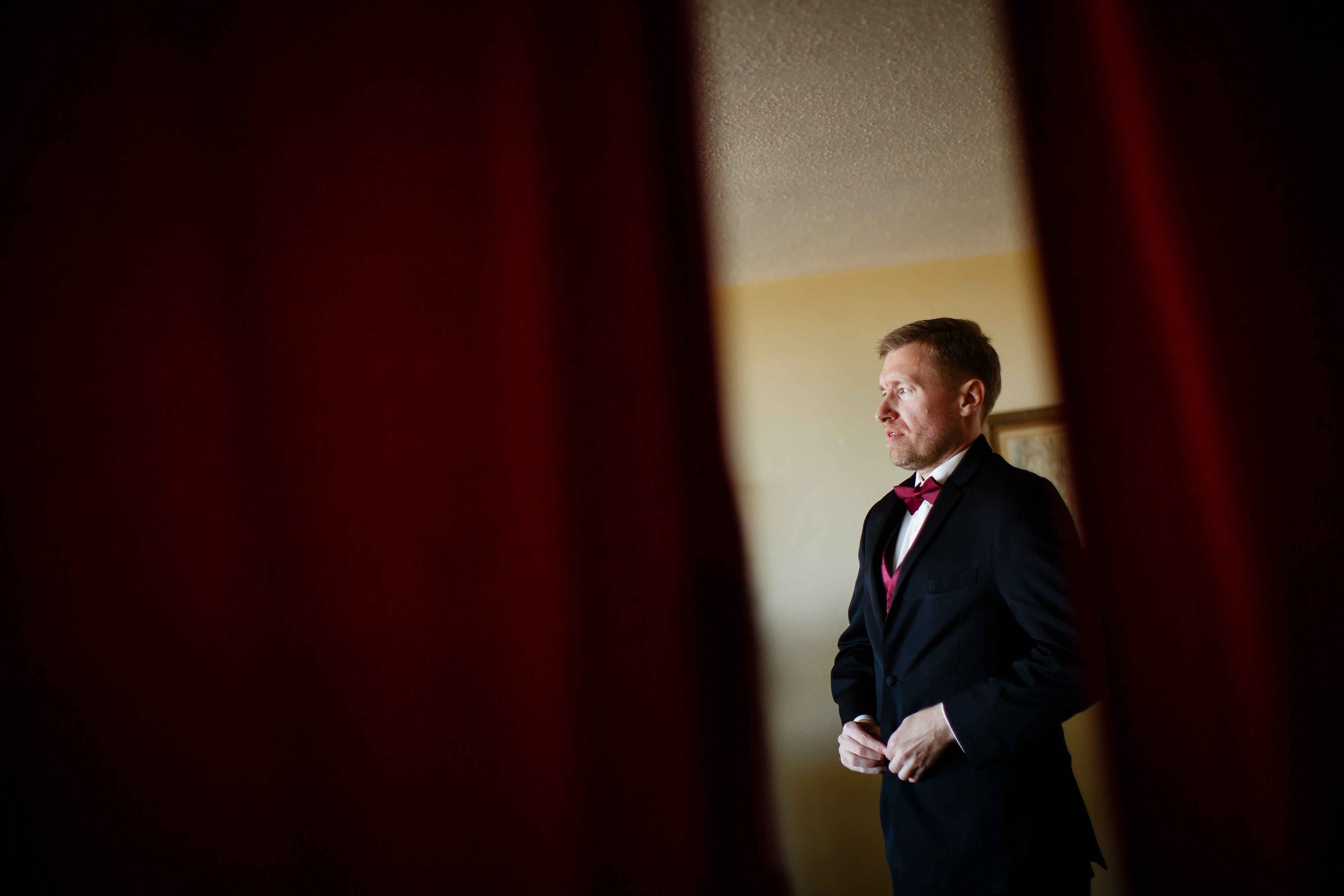 Ryan adjusts his jacket before his wedding at the Westin in Denver