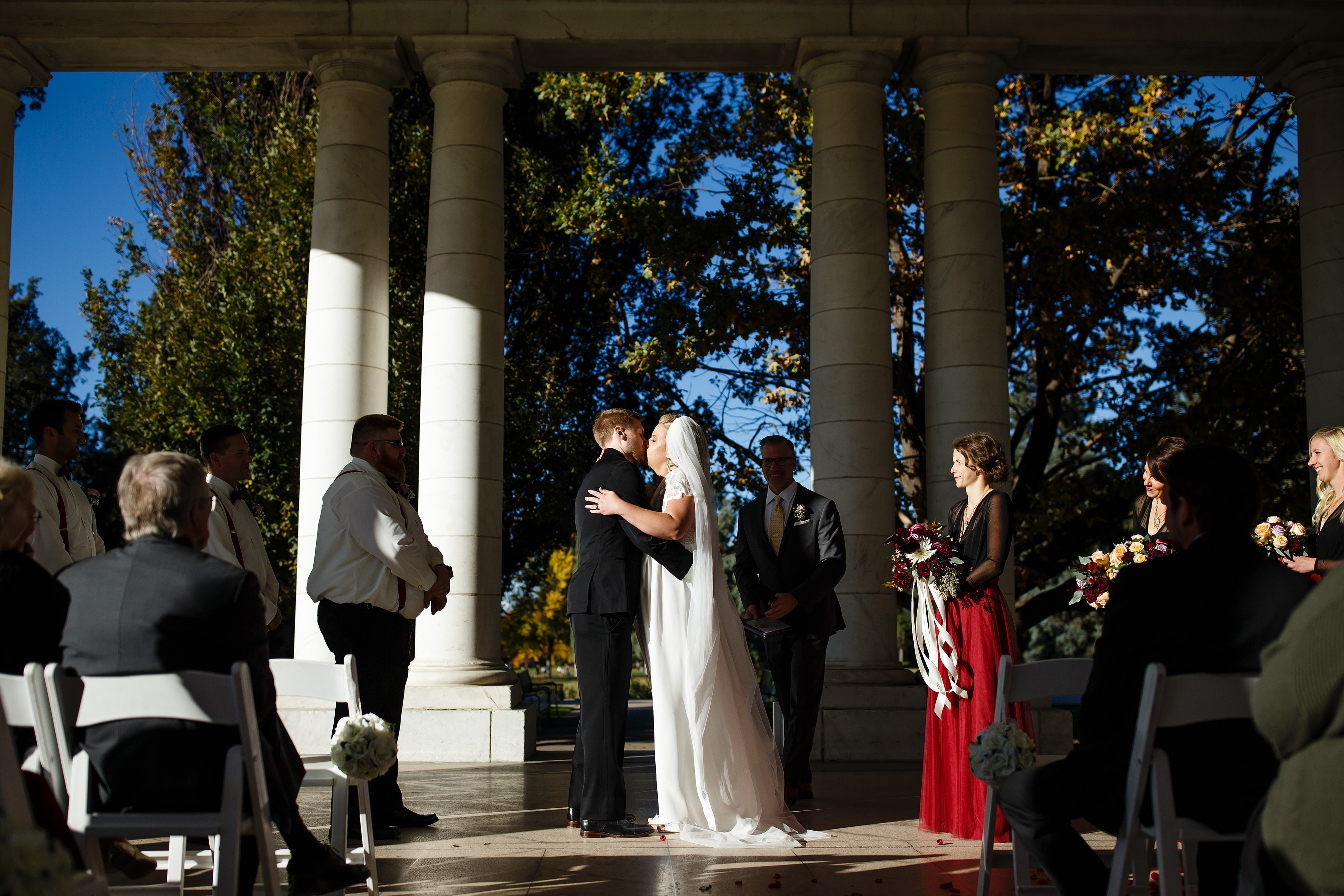 Ryan and Sarah share a kiss during their Cheesman Park wedding in Denver