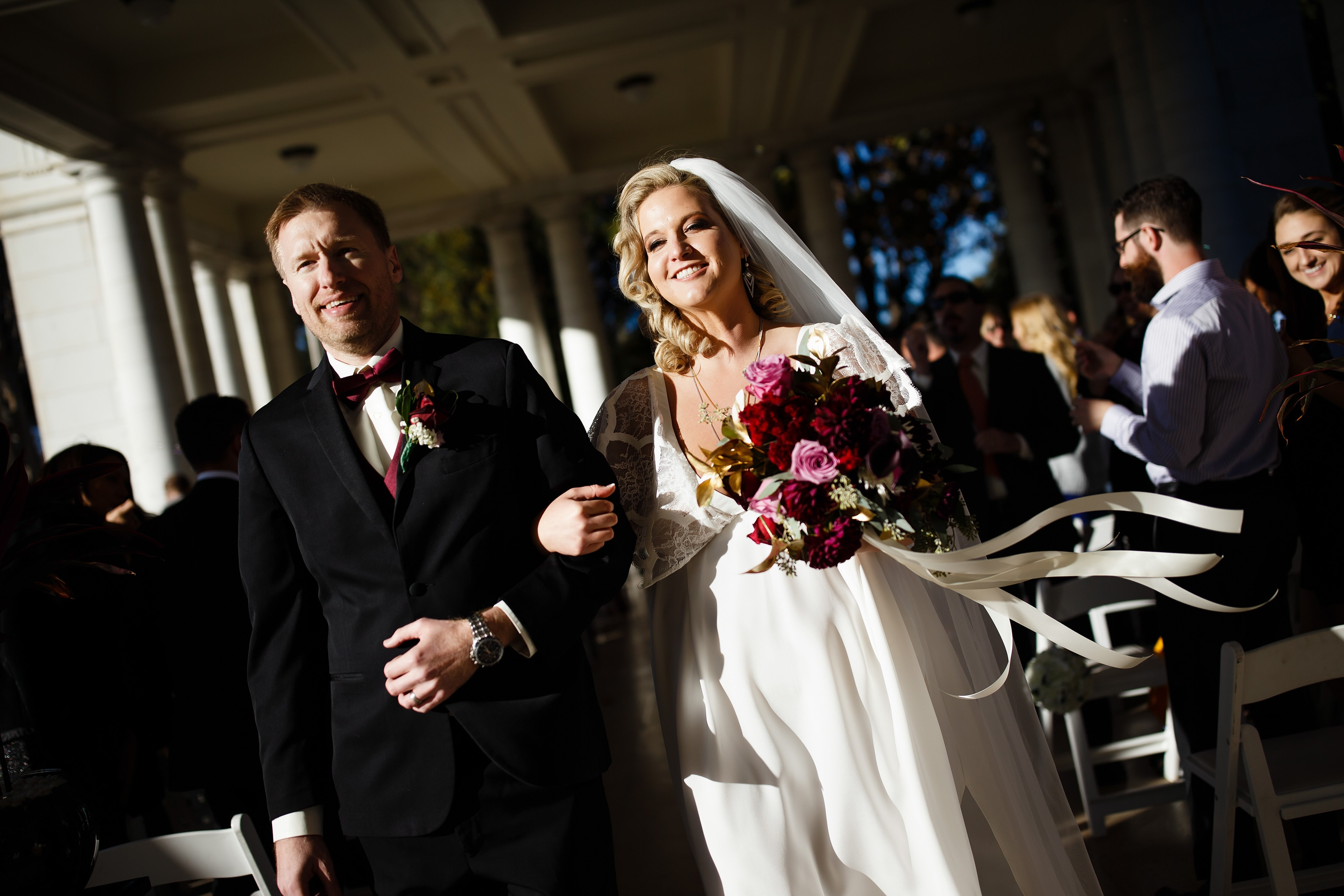 Ryan and Sarah walk down the aisle as husband and wife after their Cheesman Park wedding ceremony in Denver