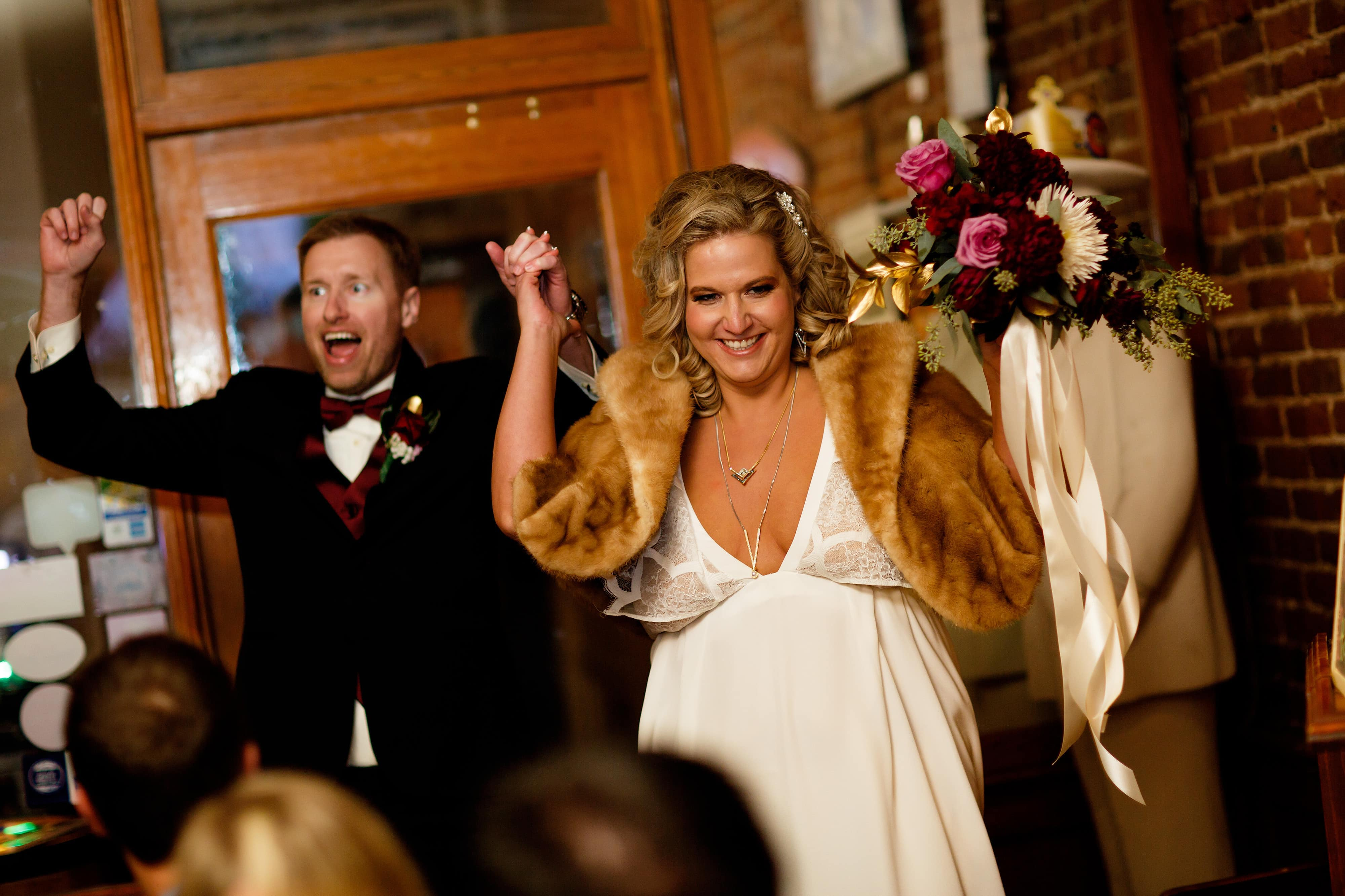 Sarah and Ryan celebrate as they are introduced for the first time at The Lobby for their wedding reception