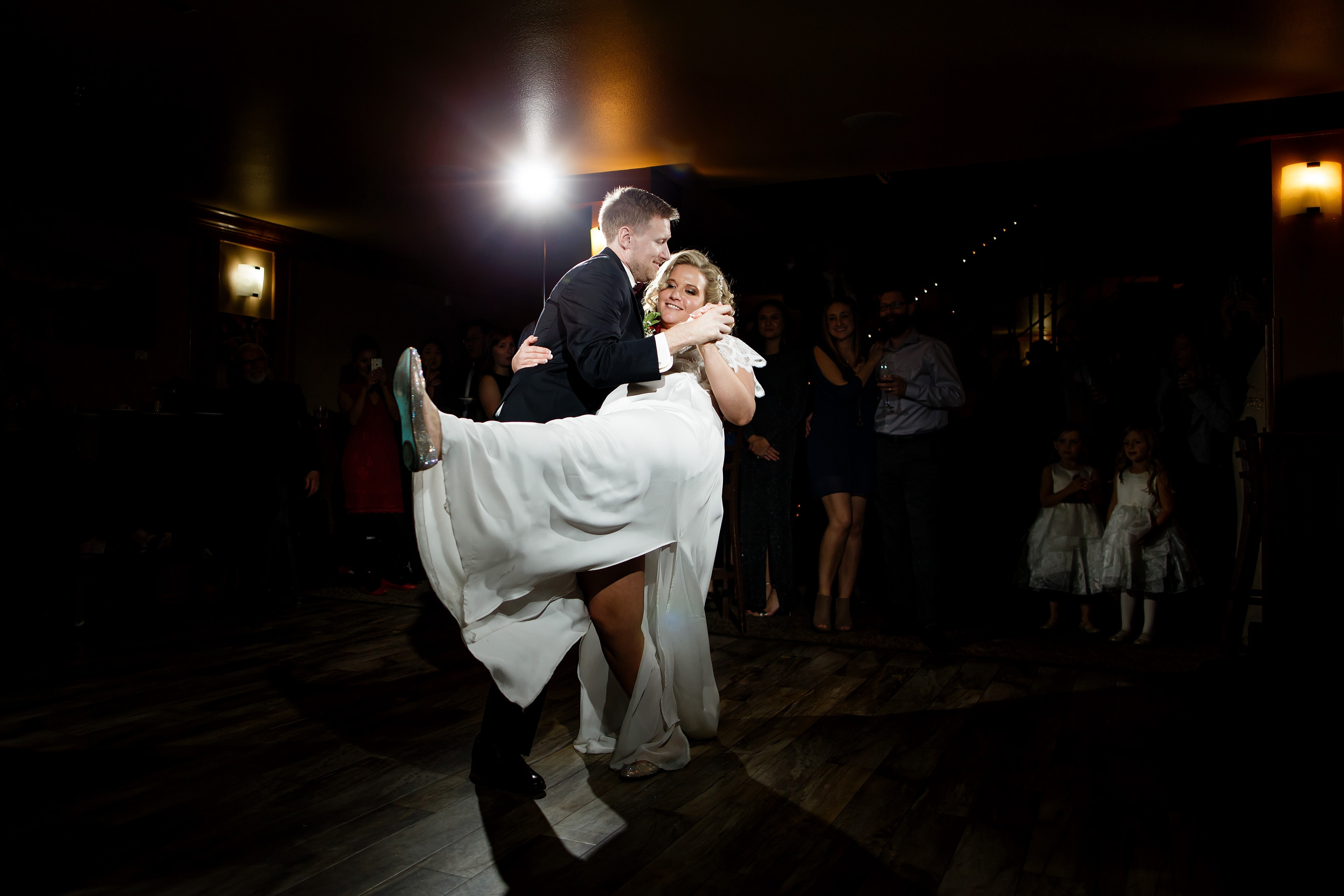 The couple share their first dance together during their wedding reception at The Lobby restaurant in Denver