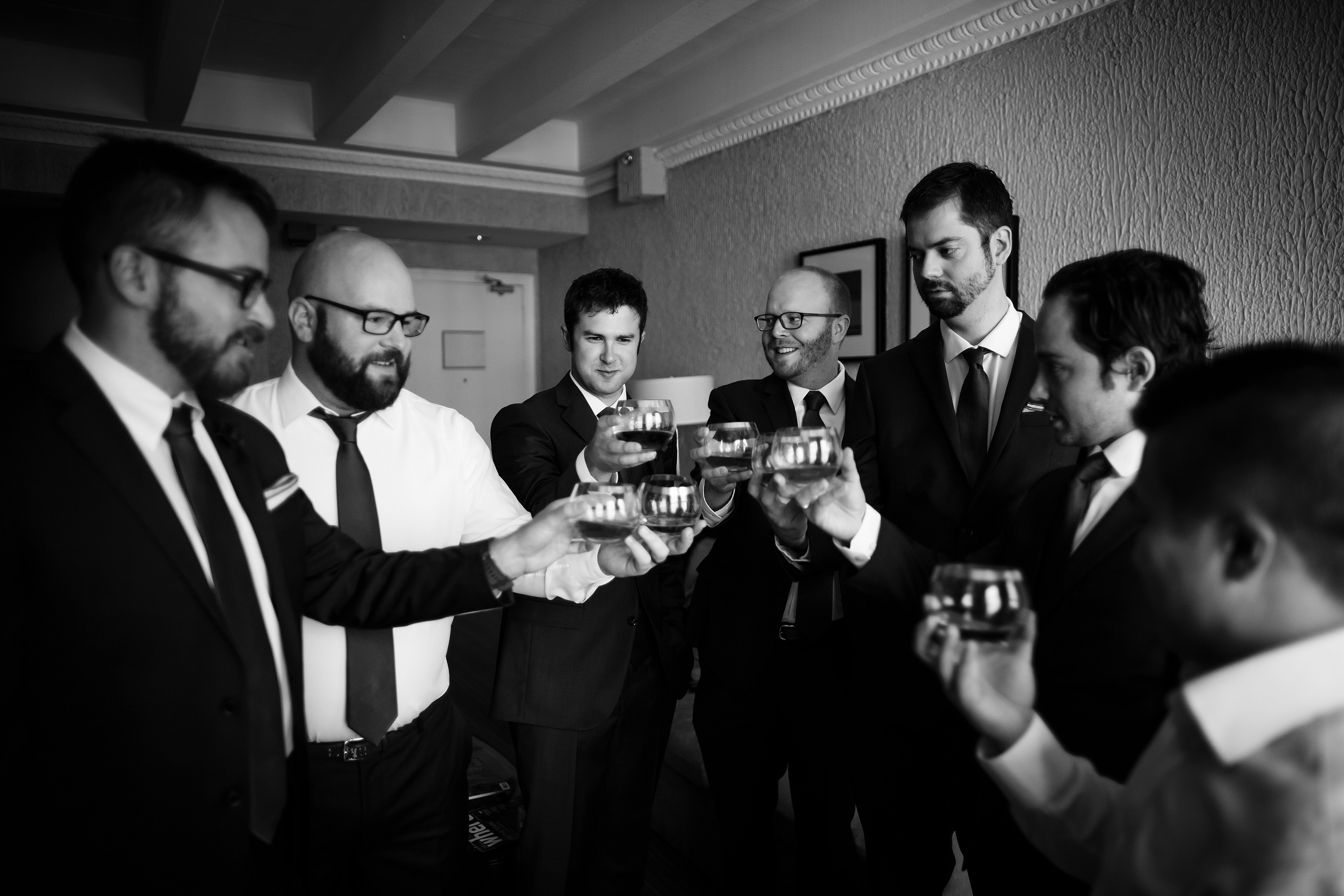 The groom and groomsmen share a drink before the ceremony
