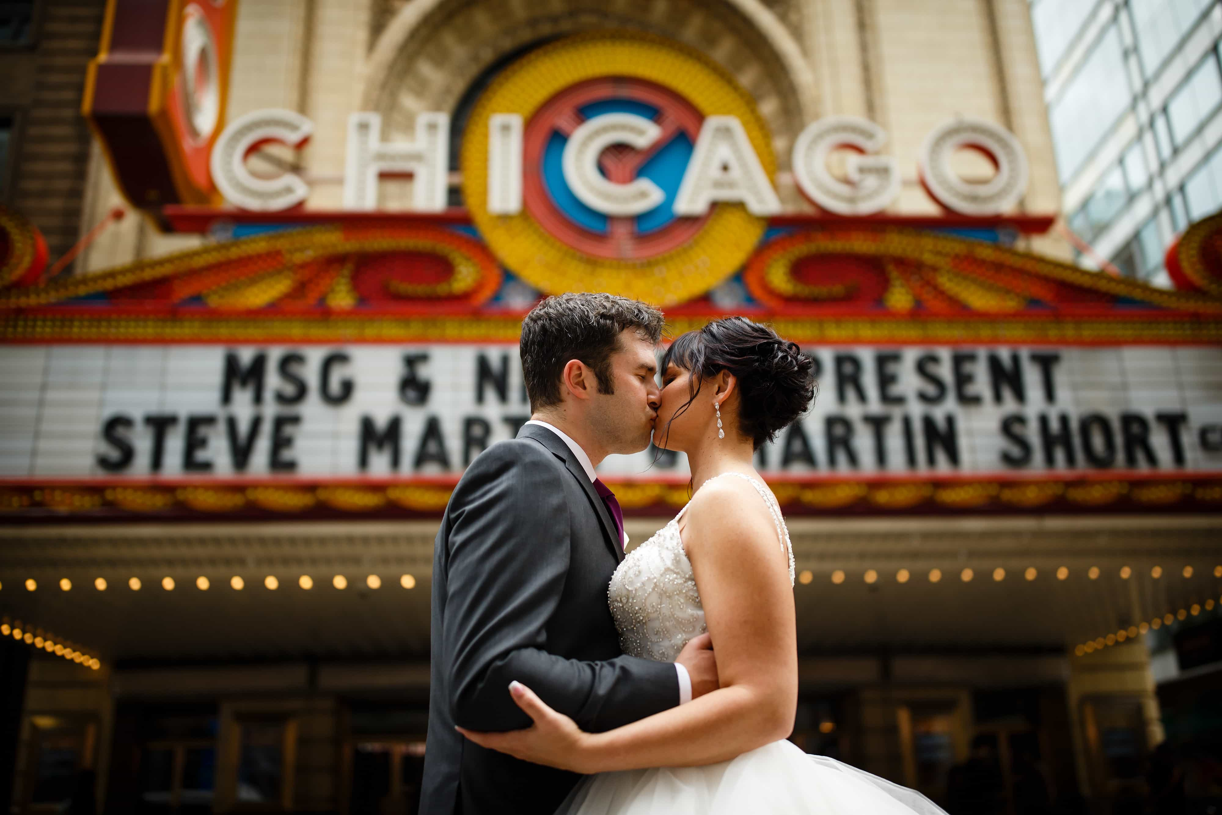 The bride and groom share a moment together outside of the Chicago Theatre during their fall wedding in October