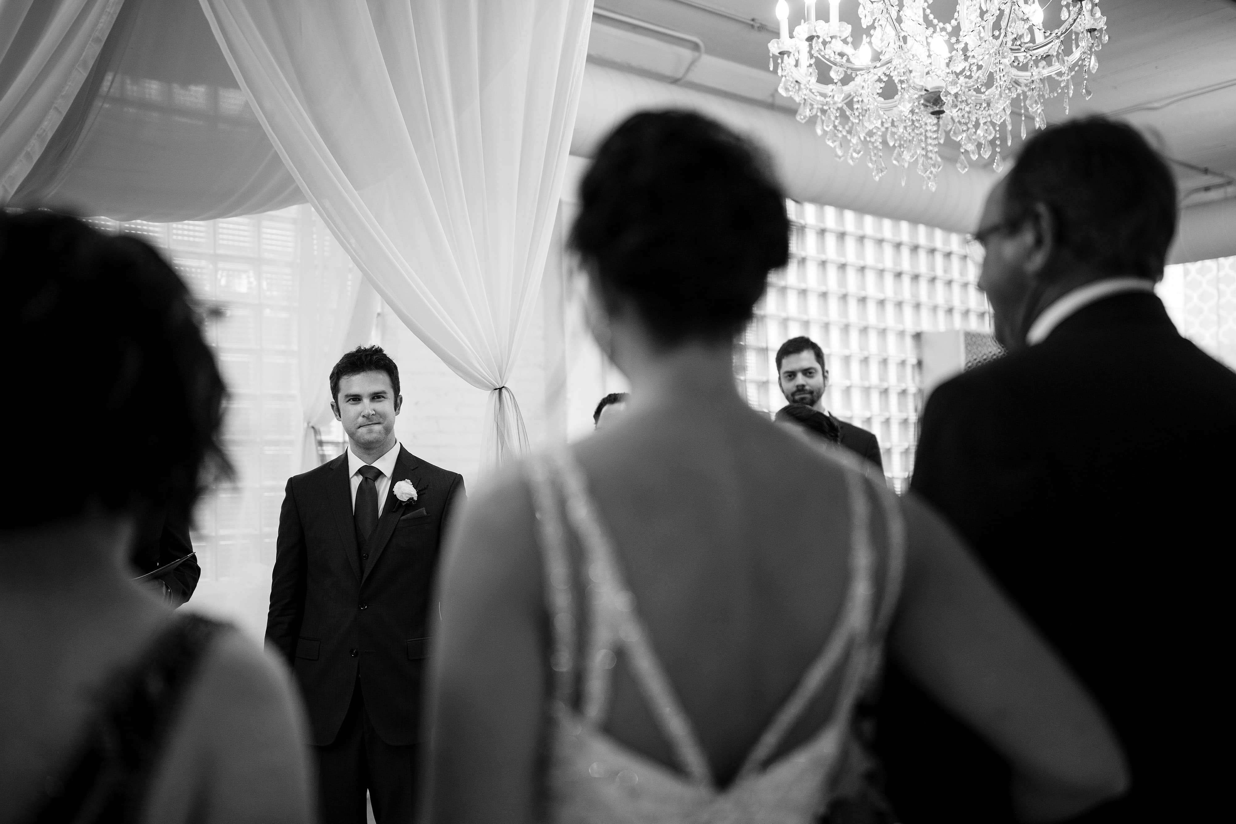 The groom looks on during the ceremony at Room 1520