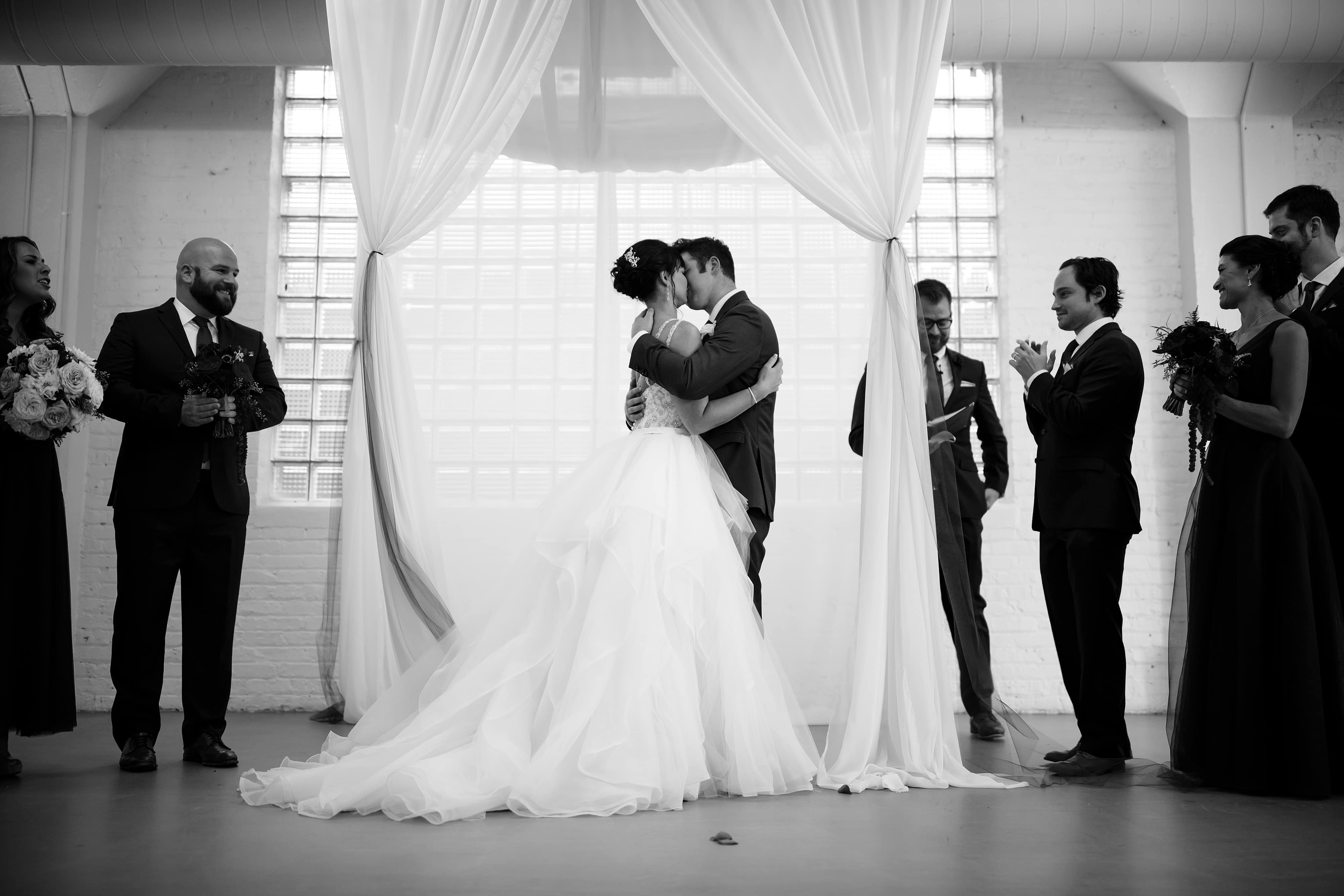 The couple kiss during their ceremony